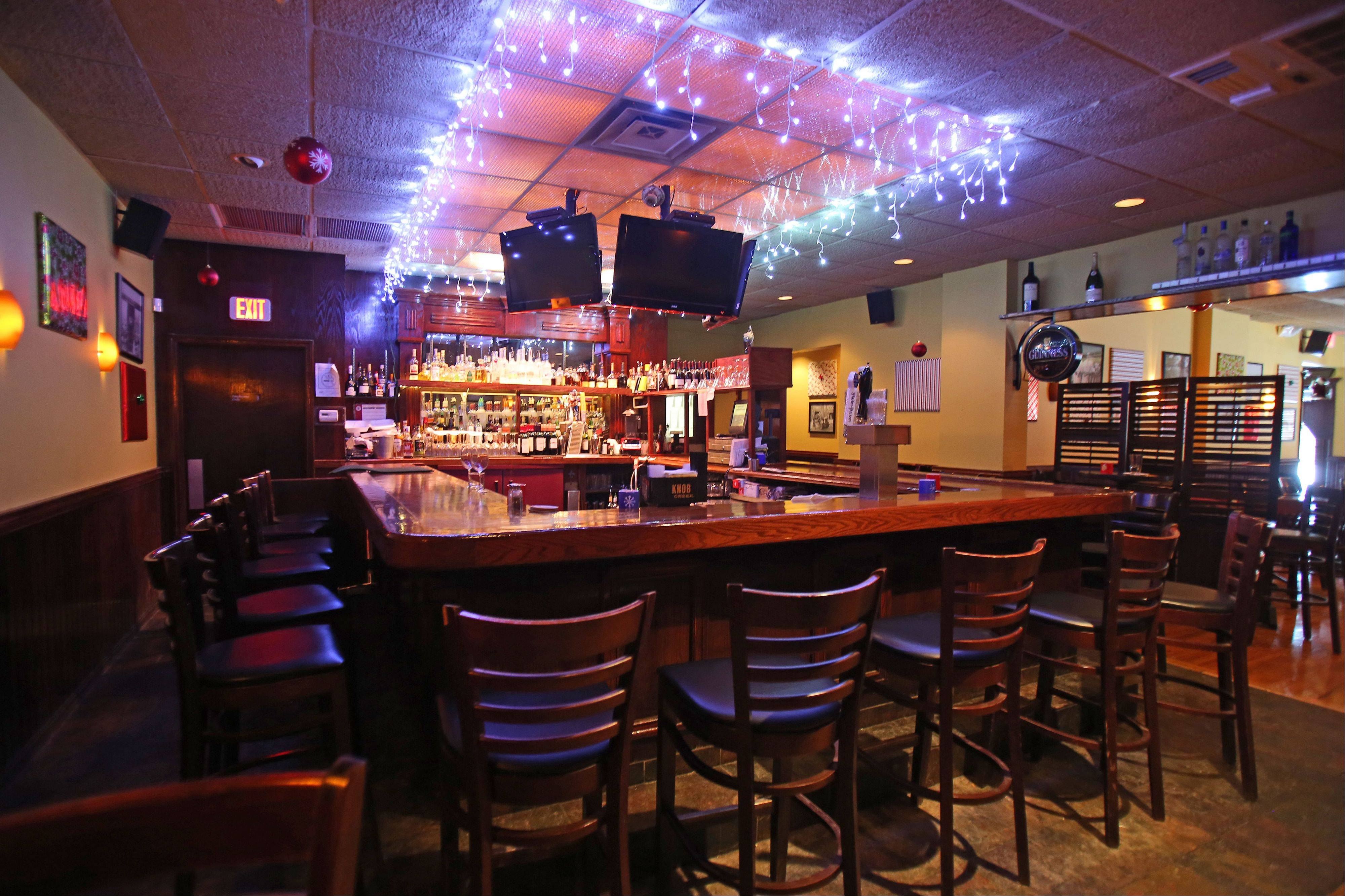 Enjoy a cocktail or glass of wine at the bar before ordering dinner at Johnny's Chophouse in Antioch.