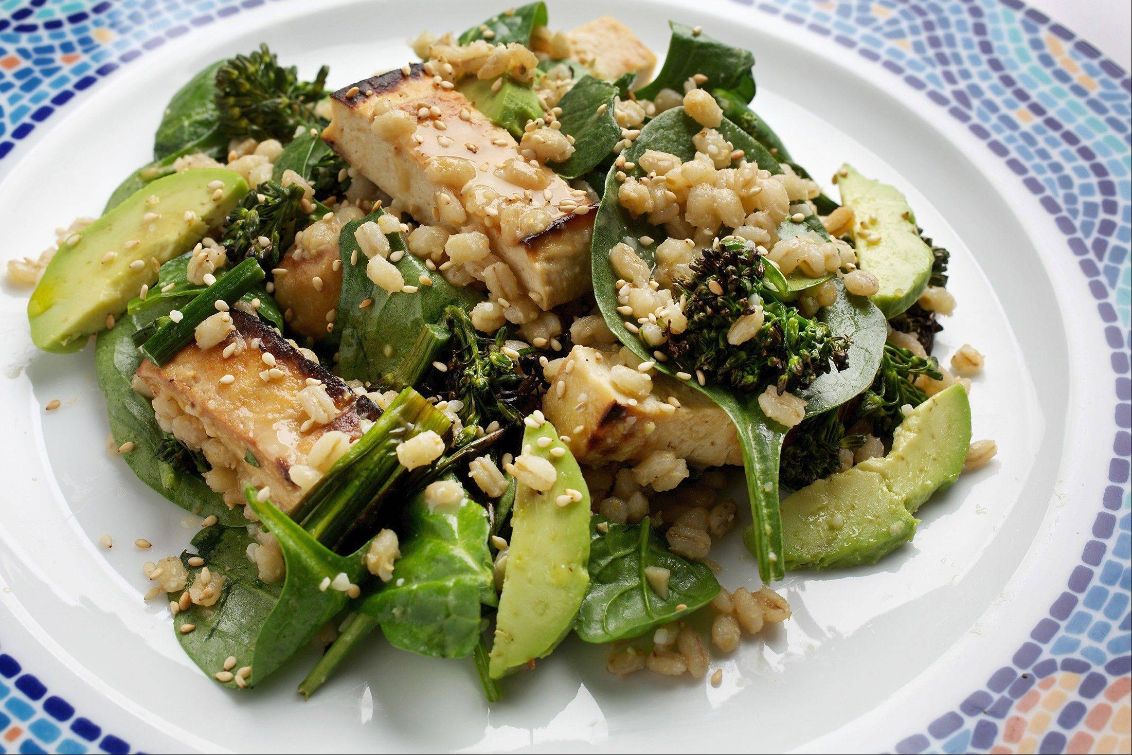 Barley and tofu add protein to a vegetarian spinach salad tossed with miso dressing.