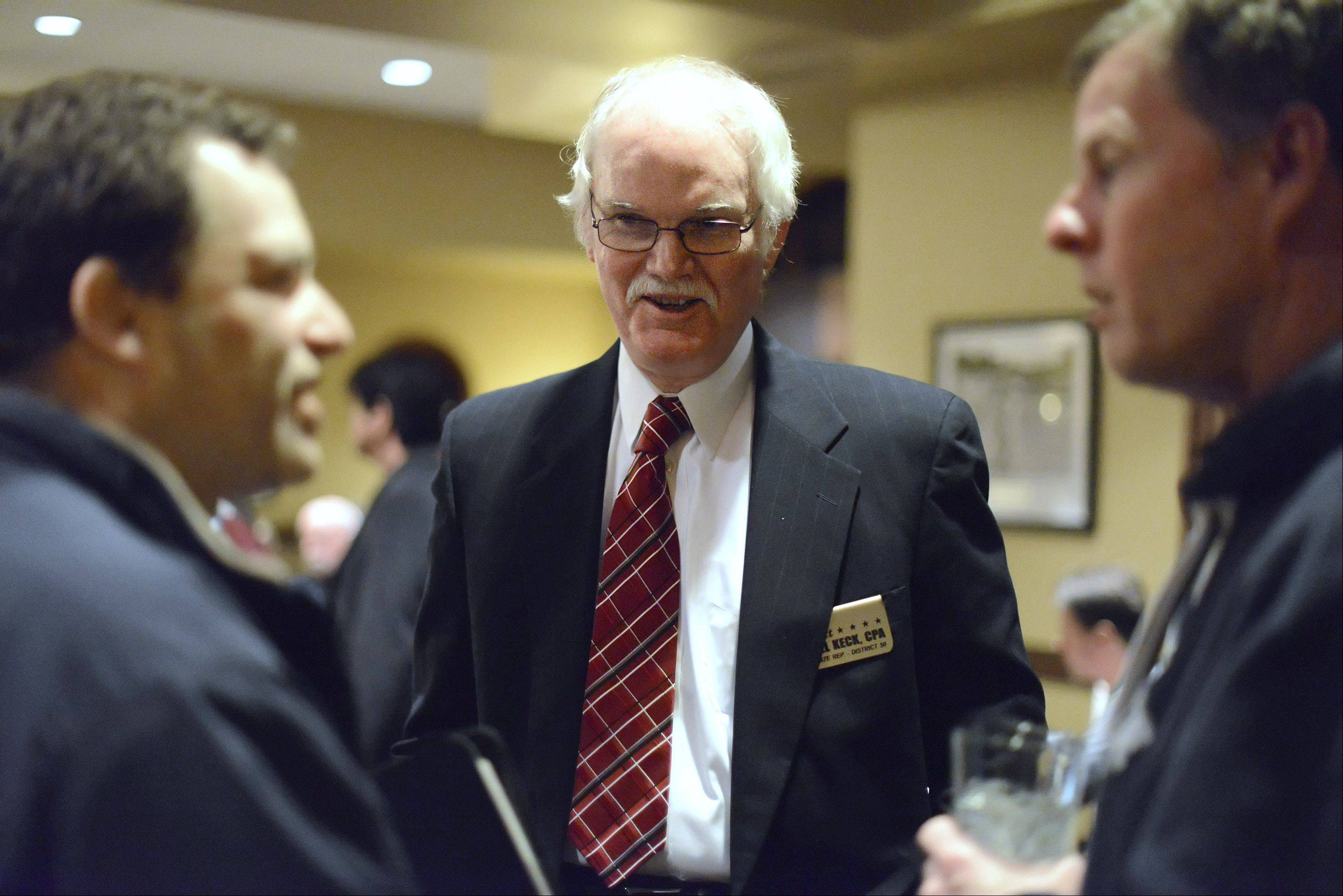 Bill Keck of Sugar Grove, center, talks with Jon Zahm, left, of Osco and Dave Richmond, of Yorkville, prior to a debate hosted by the Kane County Young Republicans at the Orchard Valley Restaurant in Aurora on Wednesday. Keck seeks the nomination for the 50th House seat in the March primary. Zahm is a political consultant; Richmond is the former supervisor of Blackberry Township, before moving to Yorkville.