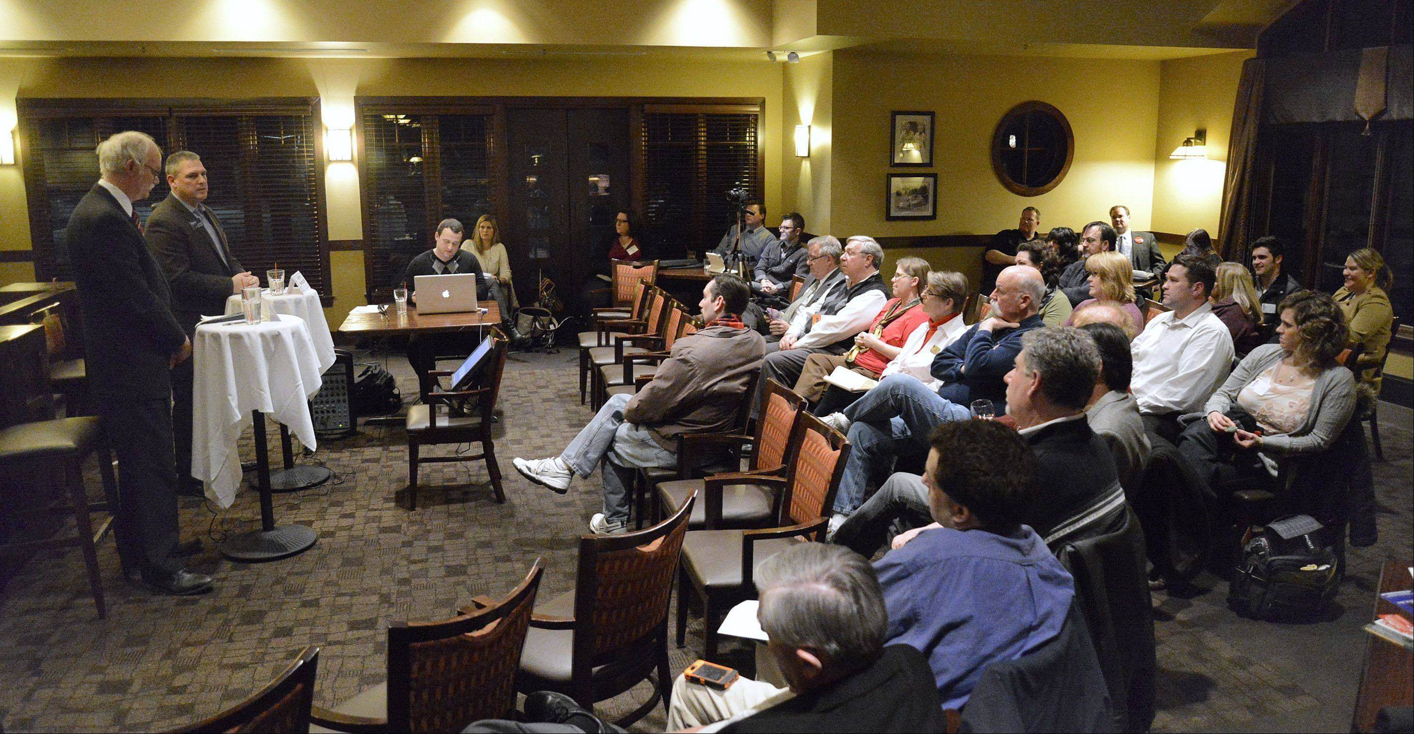 Bill Keck of Sugar Grove, left, and Keith Wheeler of Oswego join in a debate hosted by the Kane County Young Republicans in Aurora.