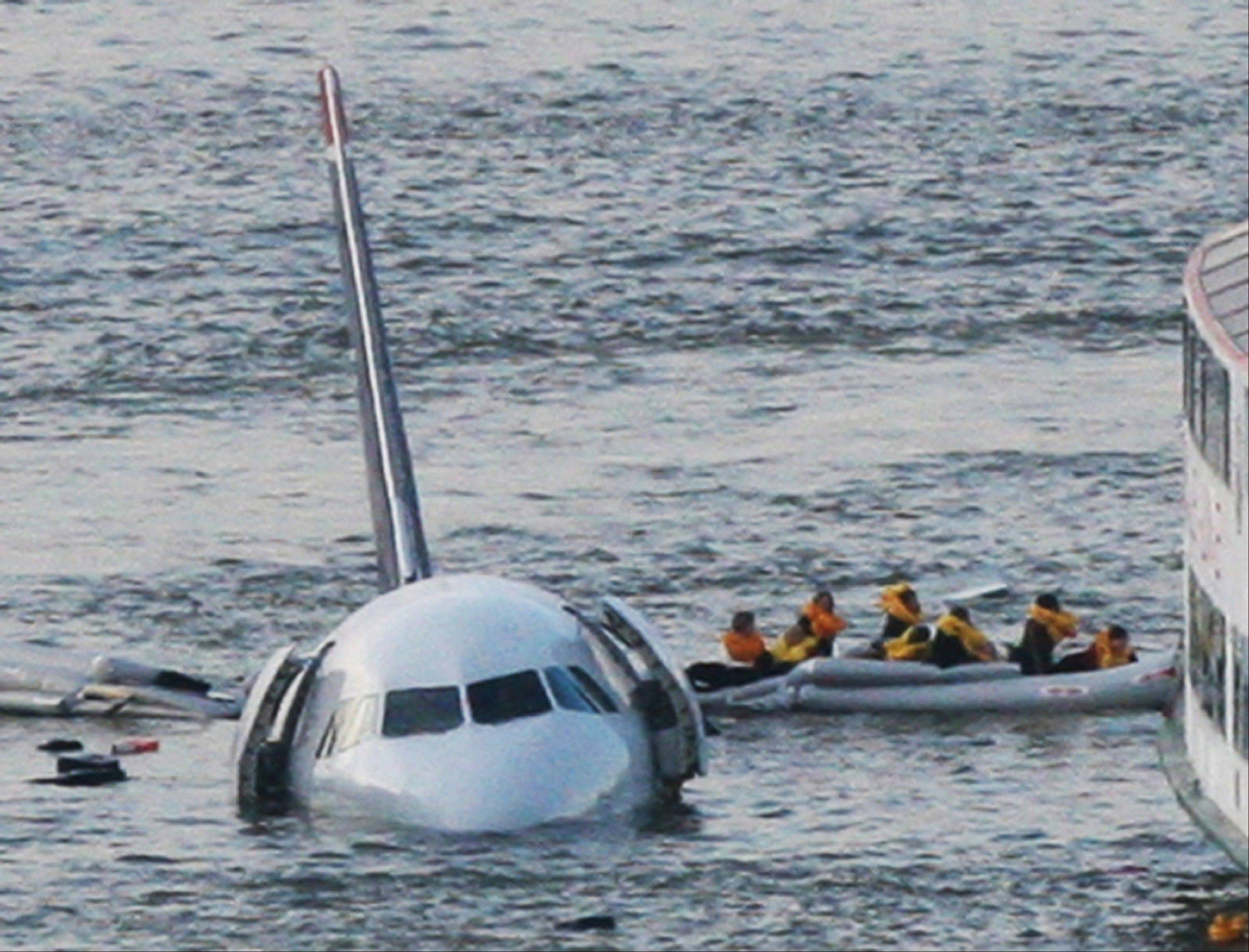Passengers in an inflatable raft move away from US Airways Flight 1549 that went down in the Hudson River in New York on Jan. 15, 2009.