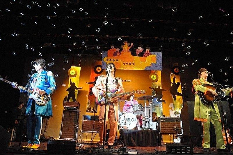American English, a Beatles tribute band, will perform July 26 in Geneva before a Kane County Cougars game.
