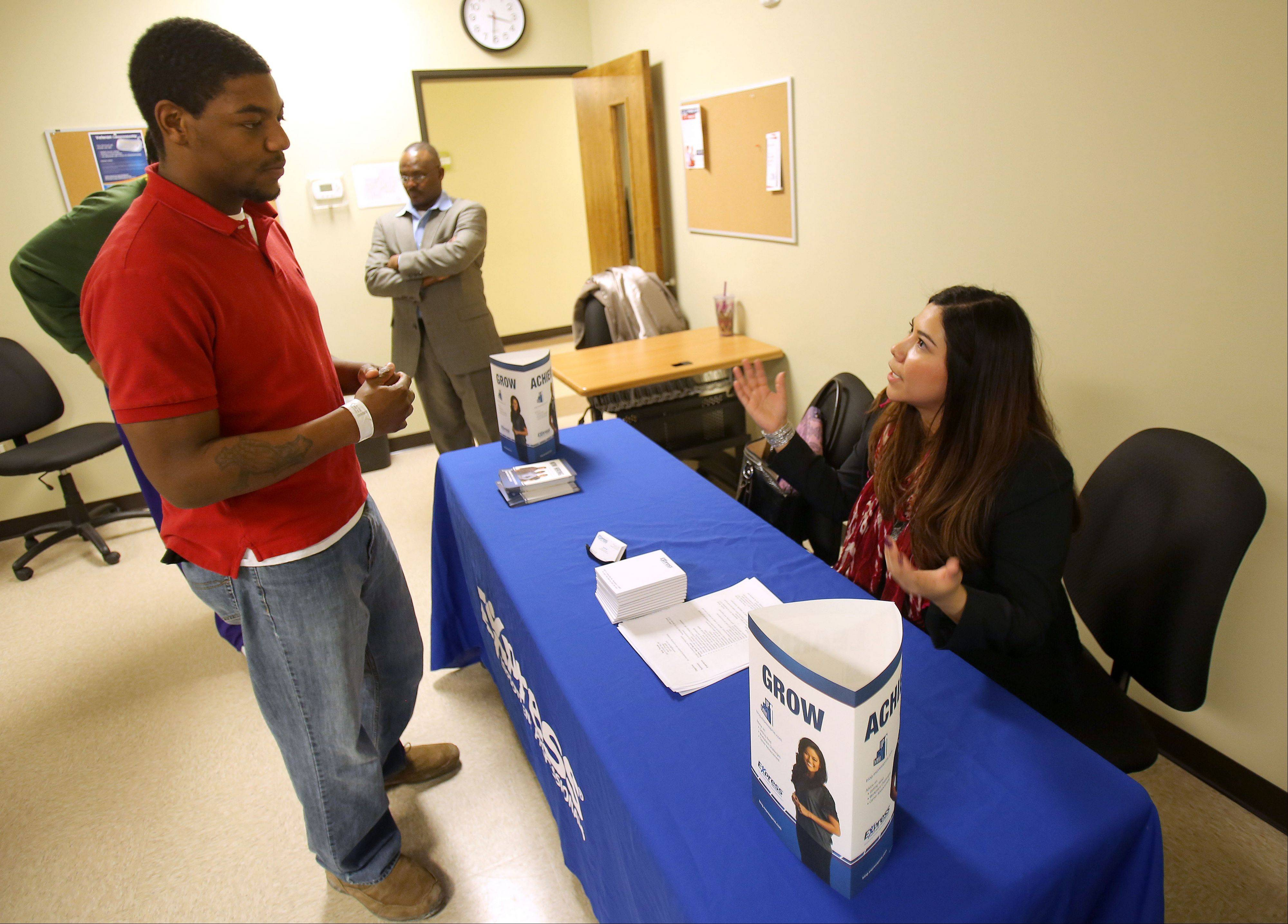 Rudy Thomas of North Chicago talks with staffing specialist Laura Leal of Express Employment Agency on Wednesday during a Veteran's Entrepreneurship Workshop at Computer Systems Institute in Gurnee.