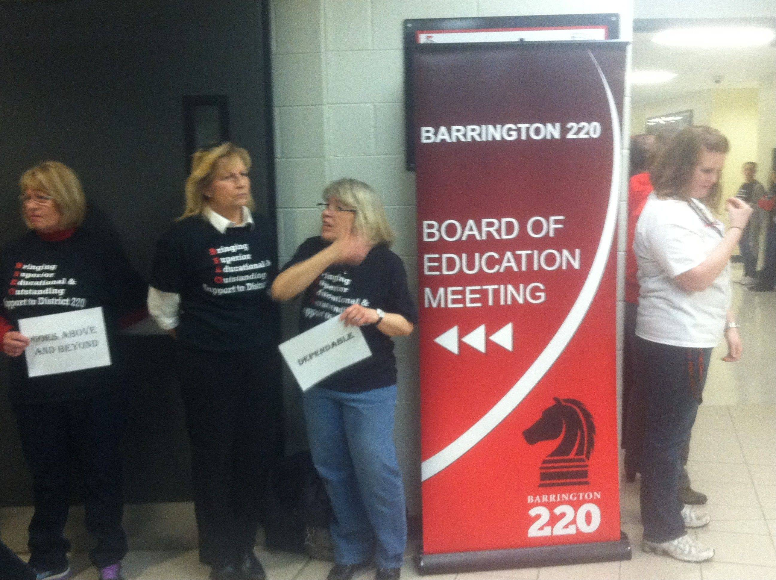Members of the Barrington School Employees Organization protested their lack of a contract outside the Barrington Unit District 220 Board of Education meeting Tuesday night. Union members say the main stumbling blocks in the negotiations are salaries and proposed increases in the employees' share of health insurance costs.