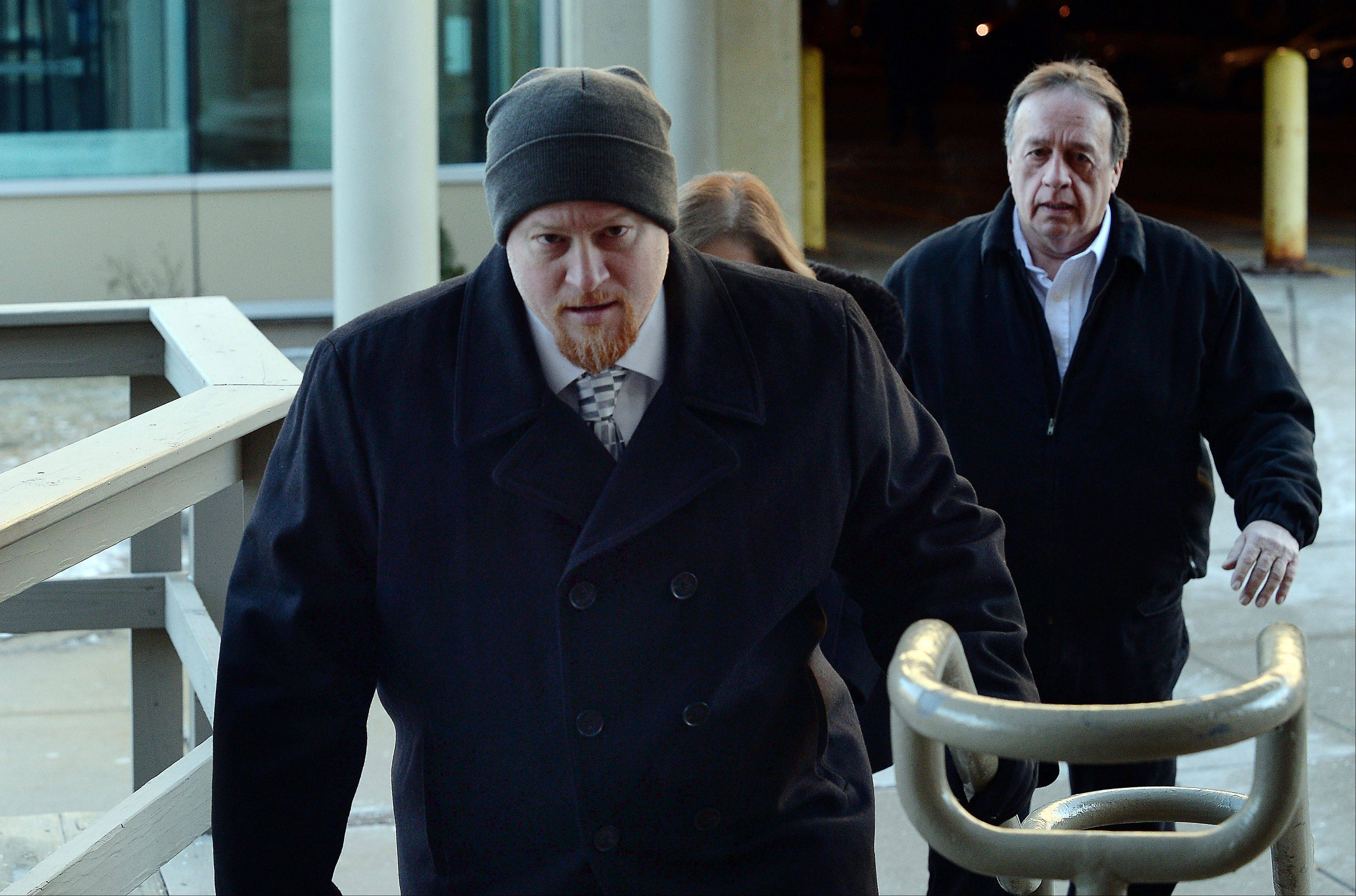 Former Maine West High School soccer coach Michael Divincenzo walks into the Cook County courthouse in Skokie, where a judge found him not guilty Wednesday of hazing-related charges.