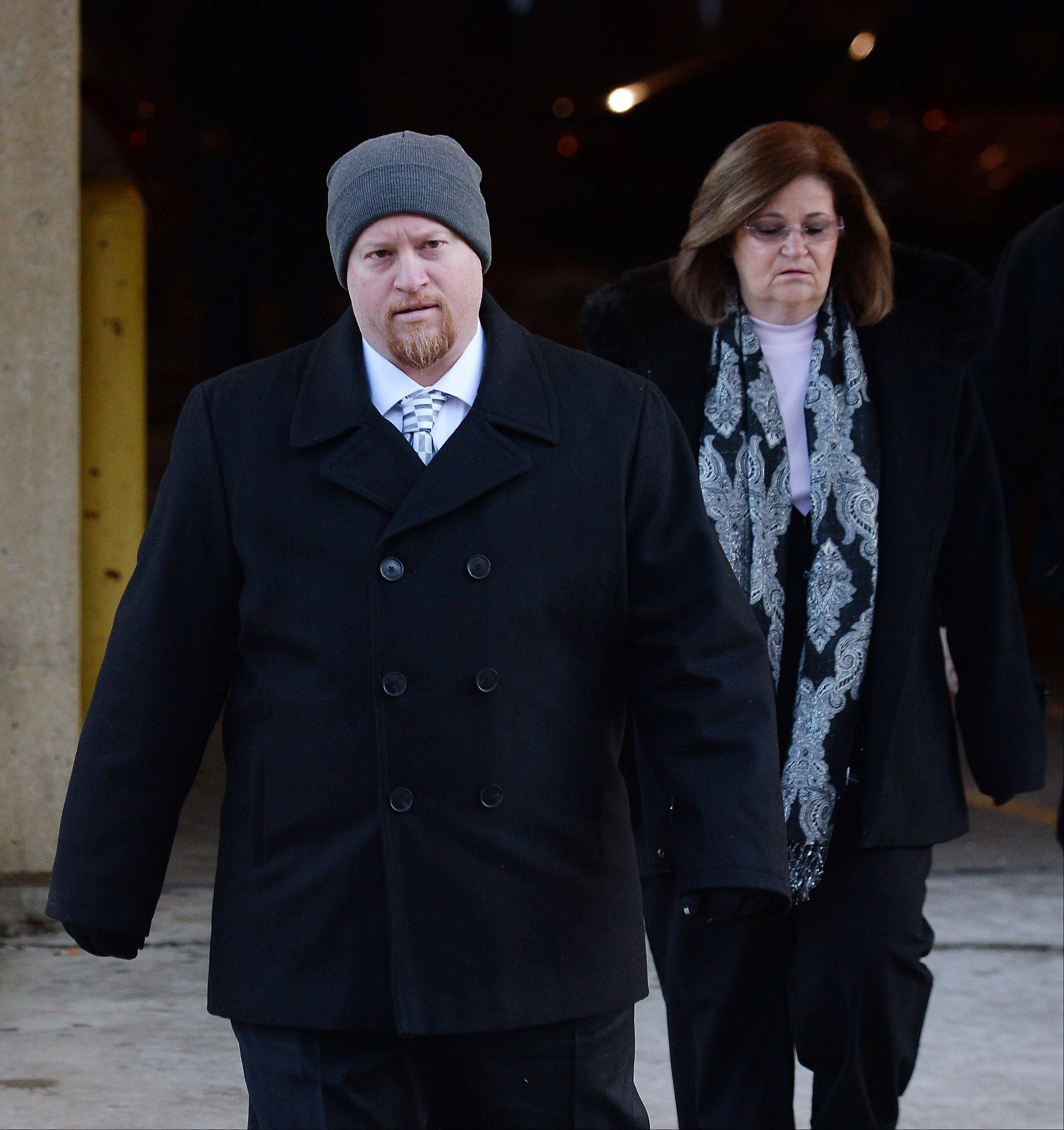 Former Maine West High School soccer coach Michael Divincenzo walks into the Cook County courthouse in Skokie Wednesday, where a judge ruled he is not guilty of hazing-related charges.