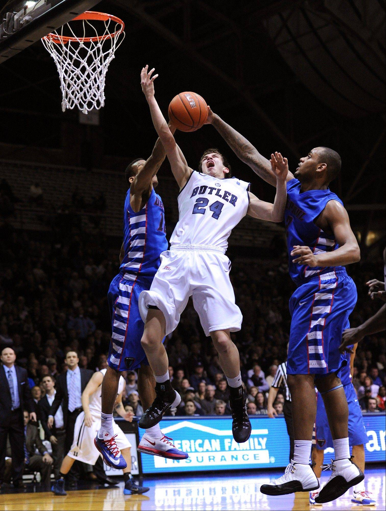 Butler guard Kellen Dunham has his shot blocked by DePaul center Tommy Hamilton IV during an NCAA college basketball game Thursday, Jan. 9, 2014, in Indianapolis. DePaul won 99-94 in double overtime.