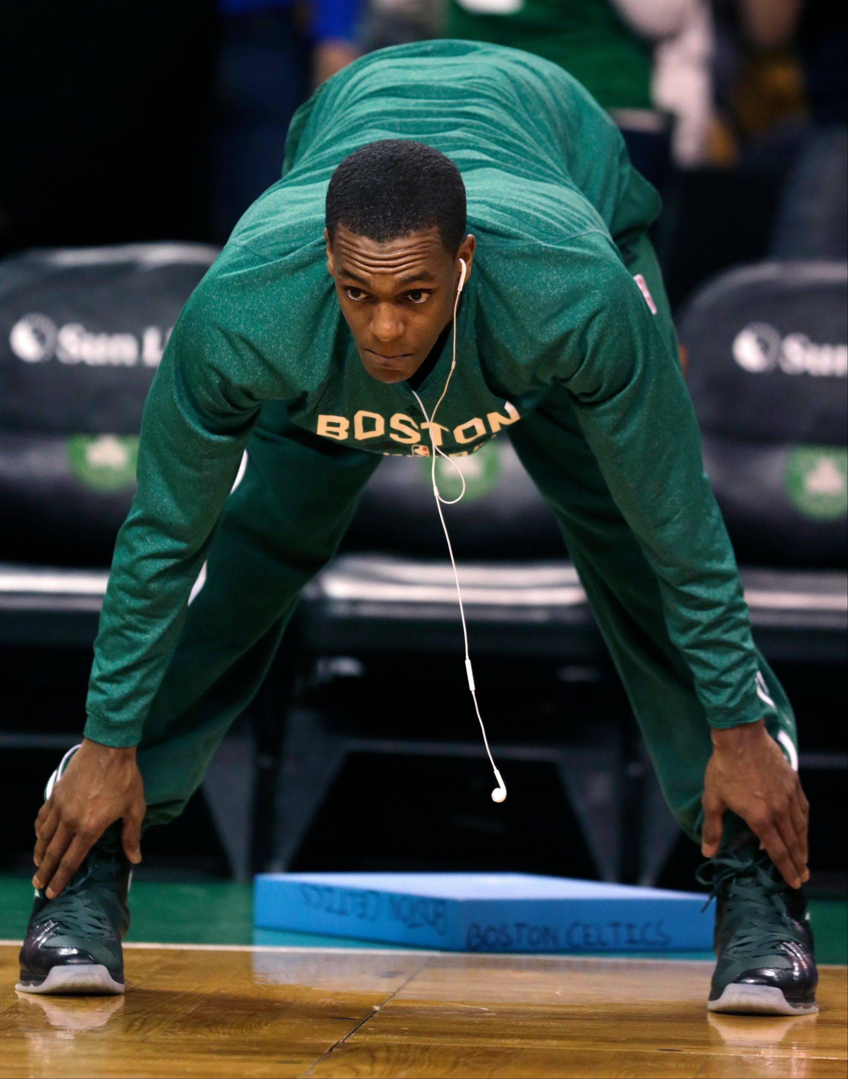 Boston Celtics guard Rajon Rondo stretches prior to an NBA basketball game against the Toronto Raptors, in Boston, Wednesday, Jan. 15, 2014. Rondo took a step toward returning to action on Wednesday, working out with members of Boston's NBA Development League team at the Celtics' practice facility earlier in the day.