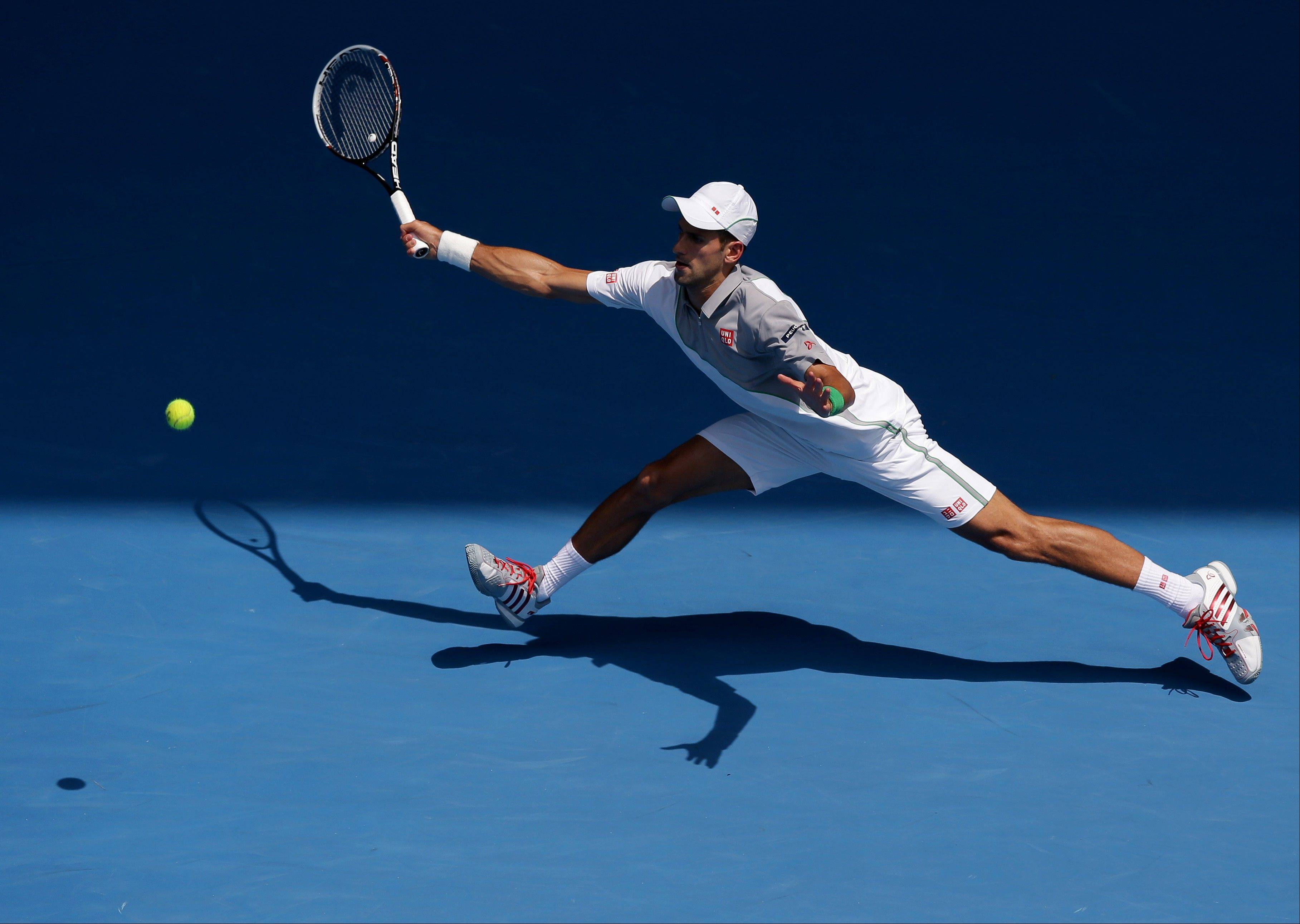 Novak Djokovic of Serbia makes a forehand return to Leonardo Mayer of Argentina during their second round match at the Australian Open tennis championship in Melbourne, Australia, Wednesday, Jan. 15, 2014.
