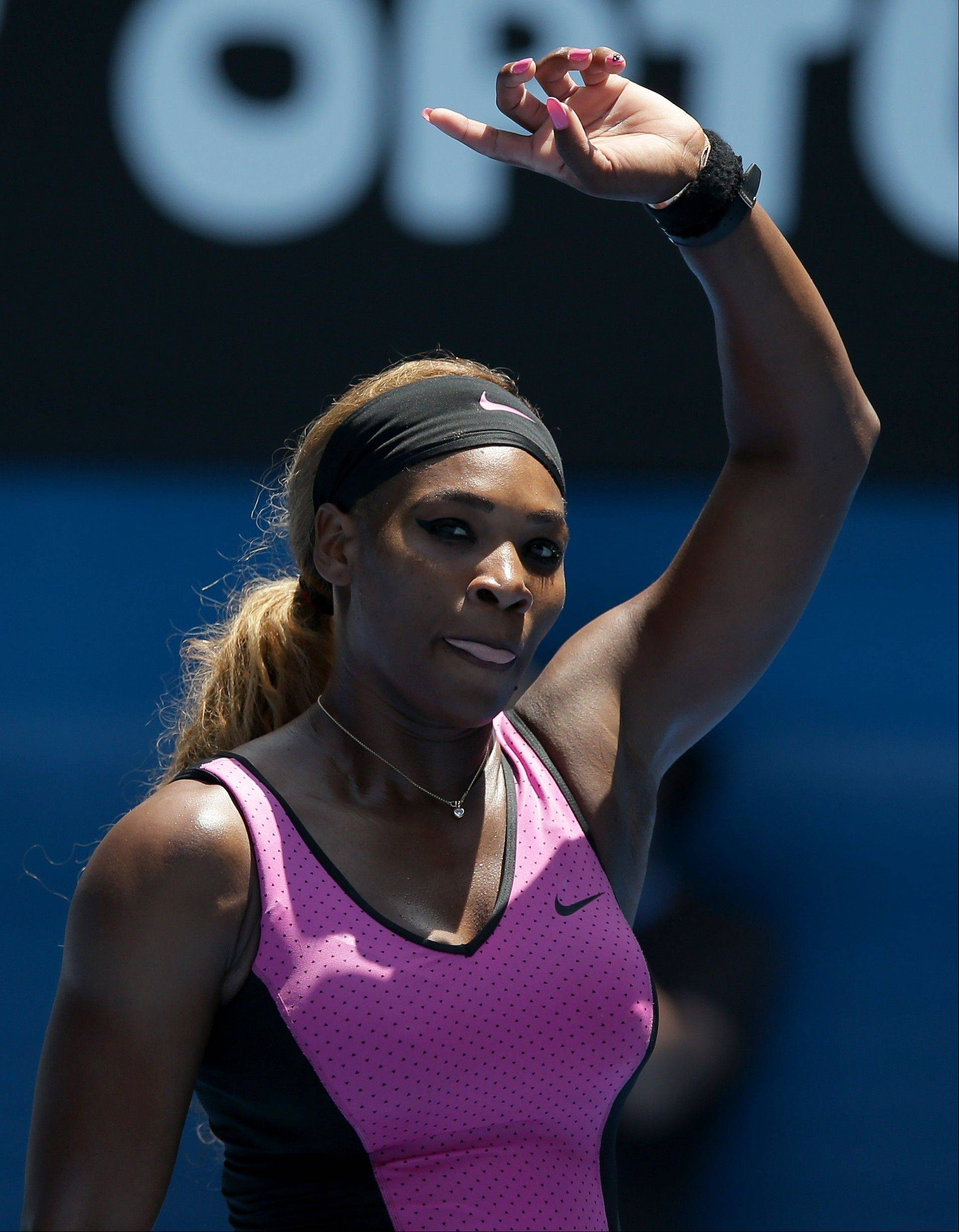 Serena Williams of the United States waves to the crowd after defeating Vesna Dolonc of Serbia in their second round match at the Australian Open tennis championship in Melbourne, Australia, Wednesday, Jan. 15, 2014.