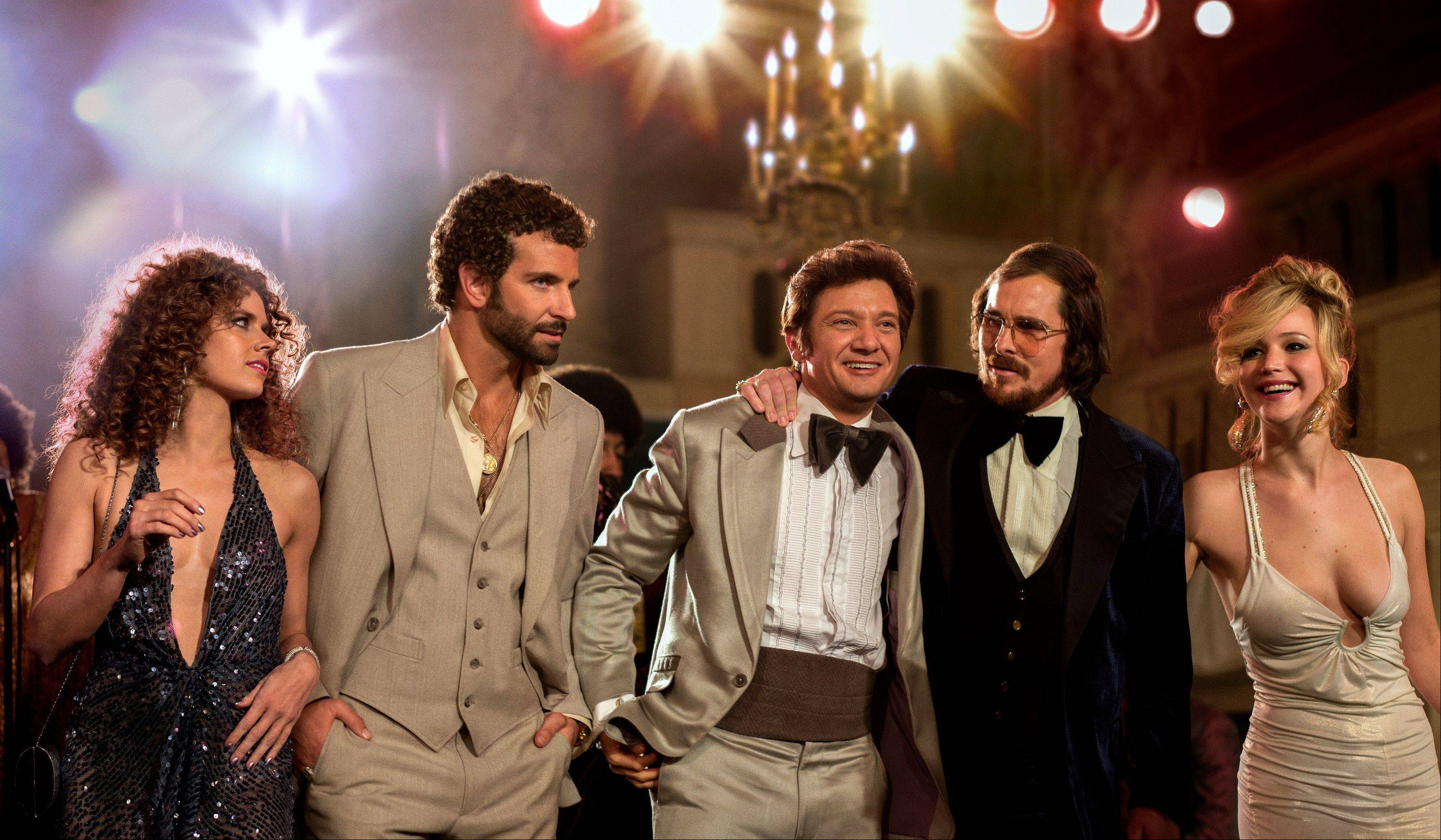 "Amy Adams, from left, Bradley Cooper, Jeremy Renner, Christian Bale and Jennifer Lawrence star in ""American Hustle,"" which was nominated for an Academy Award for best picture Thursday. The 86th Academy Awards will be held on March 2."