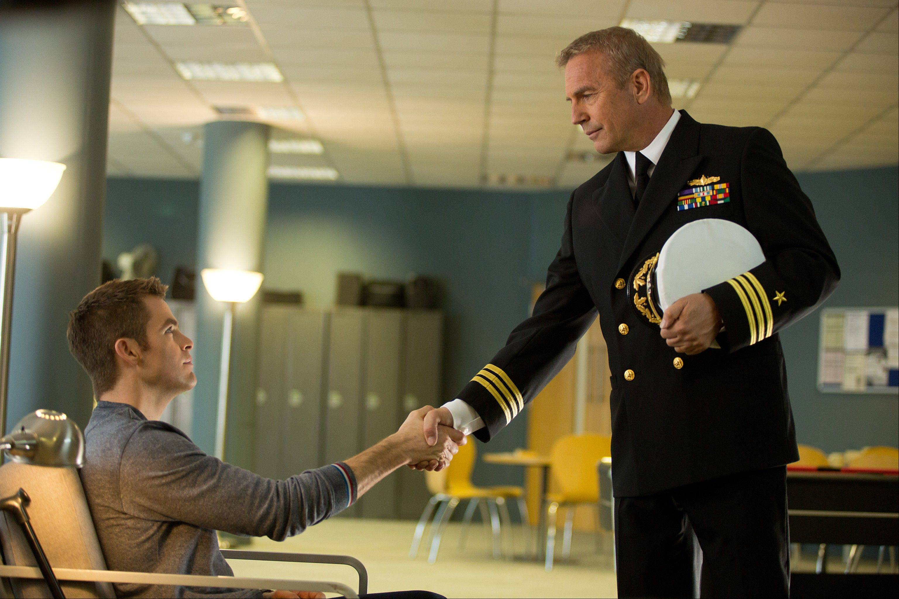 "A CIA recruiter (Kevin Costner), right, works with a young Jack Ryan (Chris Pine) in ""Jack Ryan: Shadow Recruit."""