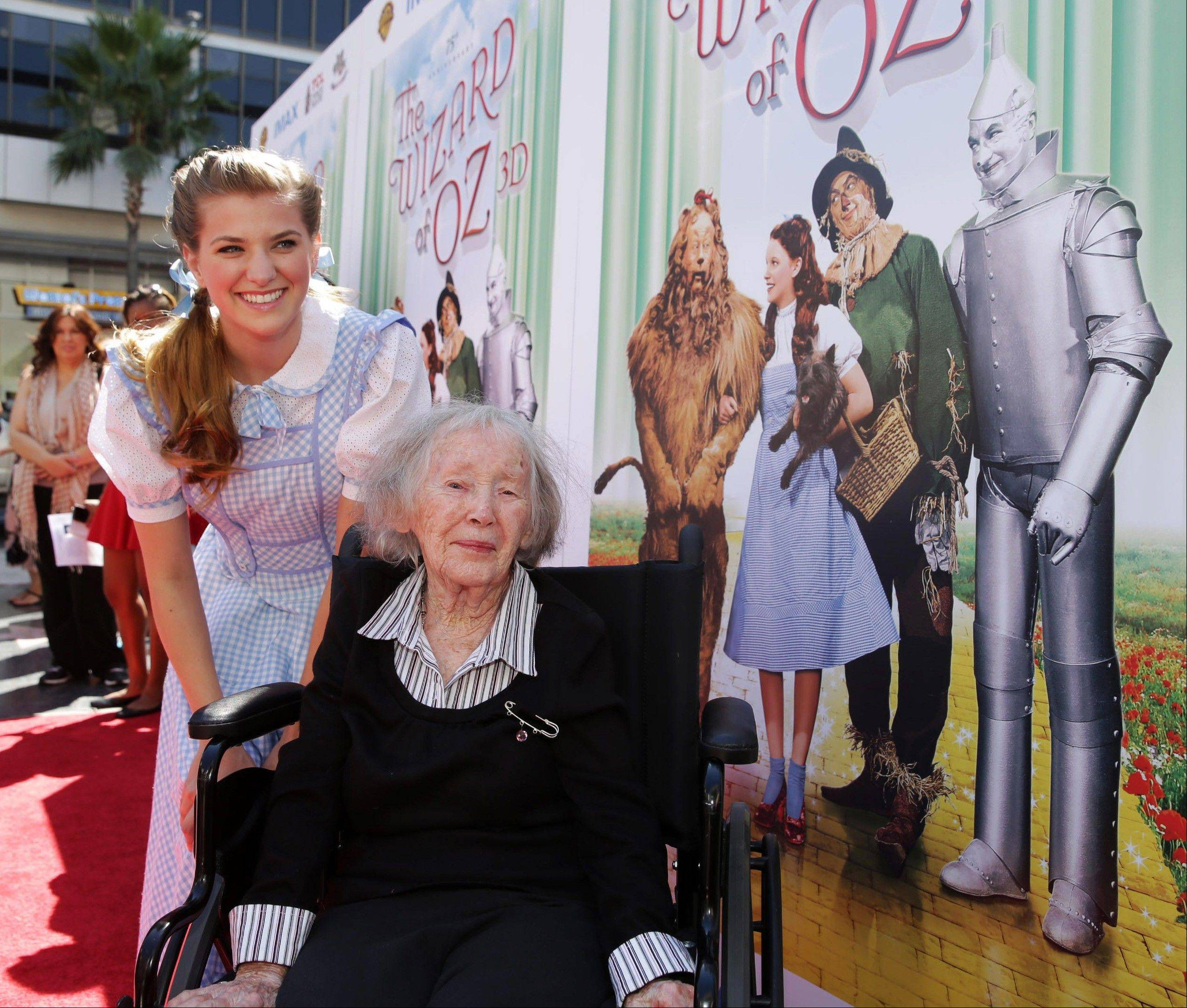 ASSOCIATED PRESS This Sept. 15, 2013 photo shows Danielle Wade, left, and Ruth Robinison Duccini at Warner Bros. world premiere screening of �The Wizard of Oz� in IMAX 3D and the grand opening of the newly converted TCL Chinese Theatre IMAX in the Hollywood section of Los Angeles. Duccini, one of the original Munchkins from the 1939 movie �The Wizard of Oz,� died Thursday. She was 95.