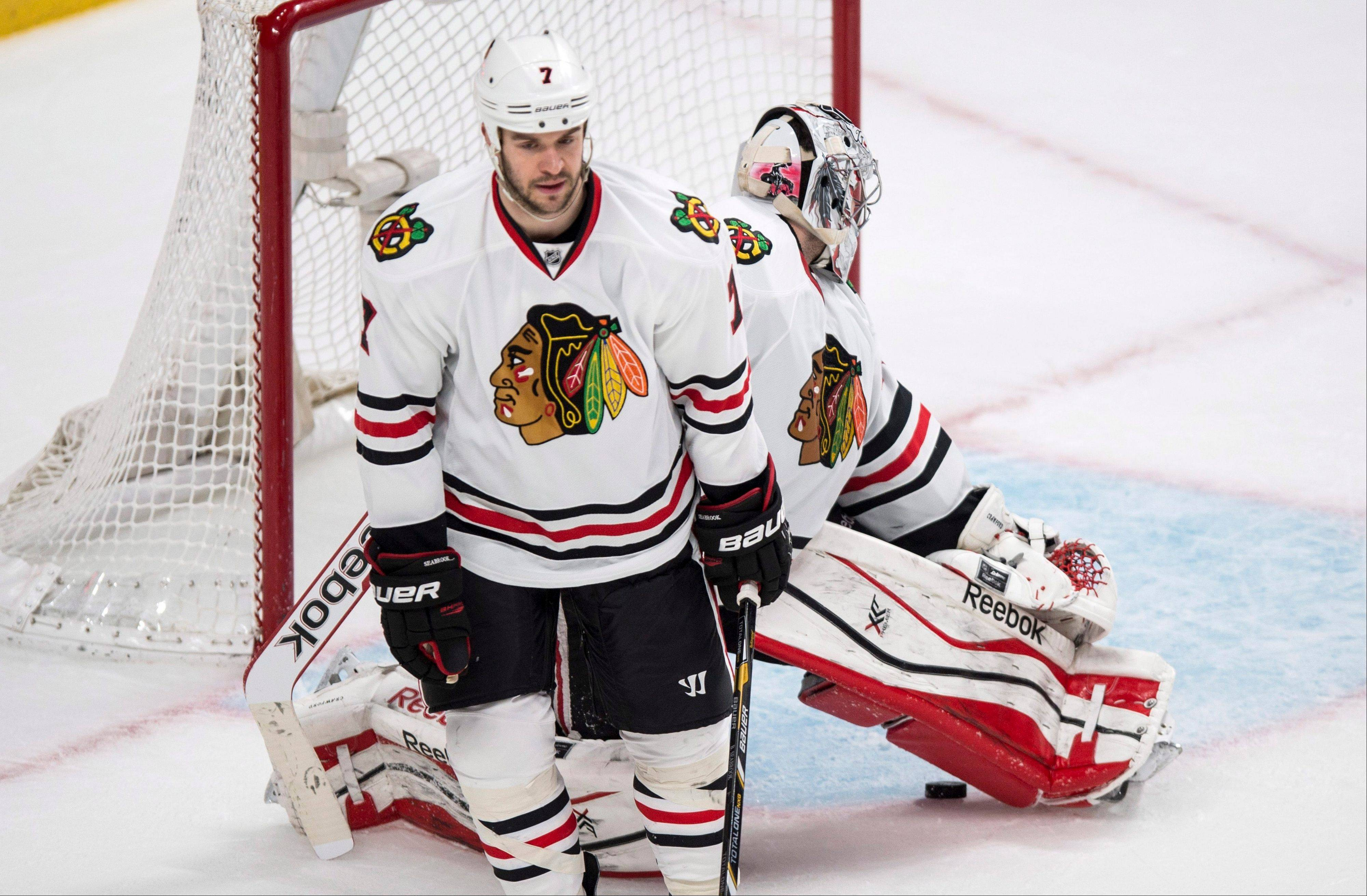 Brent Seabrook and Corey Crawford react following a goal by Montreal�s Andrei Markov during an overtime loss last week. The Hawks are 4-11 in overtimes and shootouts this season.