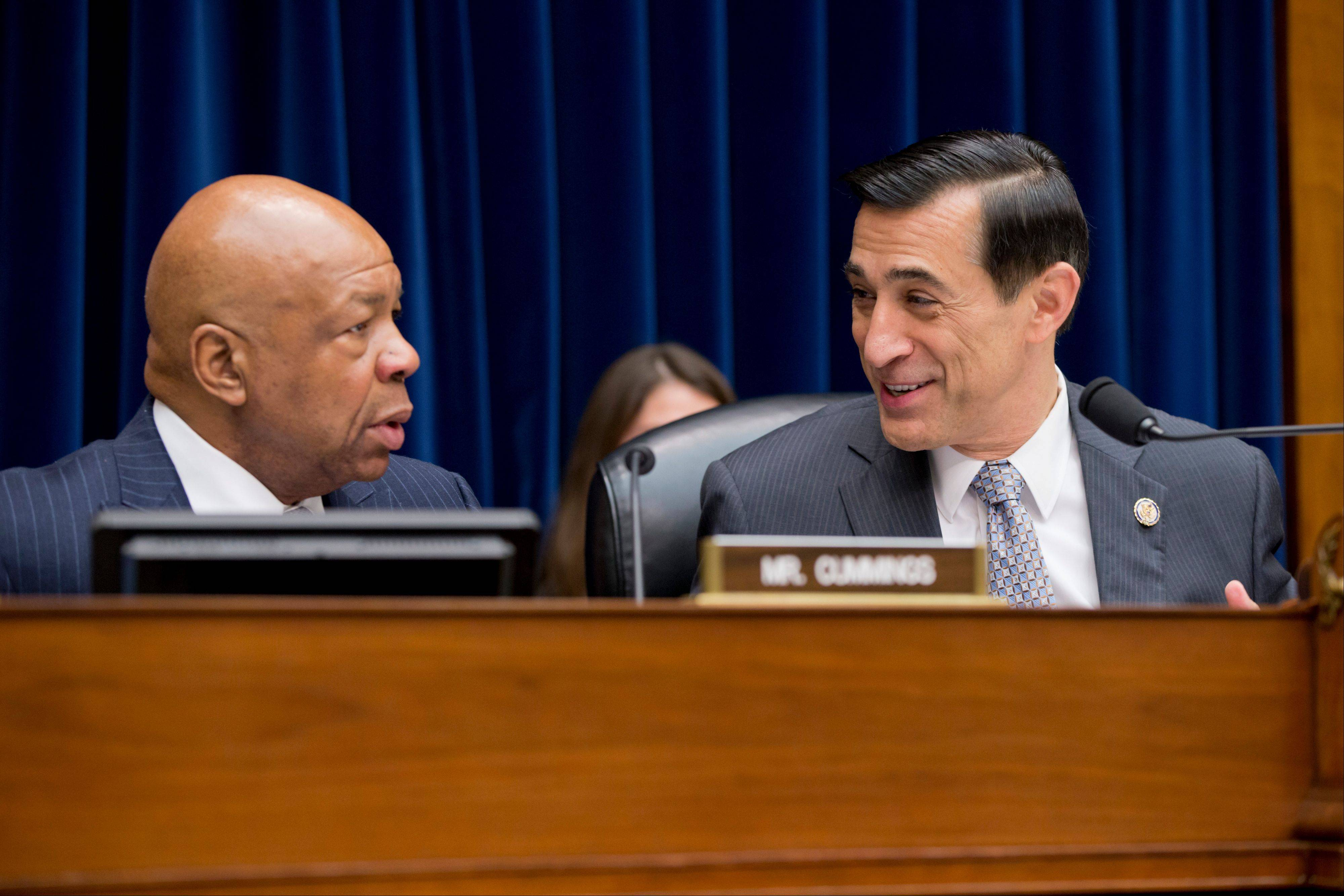 House Oversight and Government Reform Committee Chairman Rep. Darrell Issa, R-Calif., right, confers with the committee's ranking Democrat, Rep. Elijah Cummings, D-Md., on Capitol Hill in Washington, before the start of the committee's hearing on the implementation of the Affordable Care Actís HealthCare.gov website.
