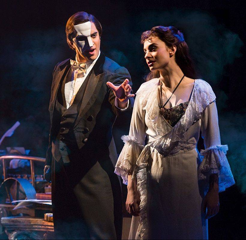 "The Phantom (Cooper Grodin) employs the music of the night to seduce young Christine (Julia Rose Udine) in ""The Phantom of the Opera"" running through March 2 at the Cadillac Palace Theatre."