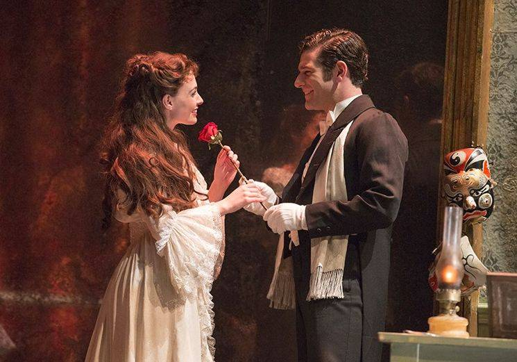 "Childhood sweethearts Christine (Julia Rose Udine) and Raoul (Marriott Theatre veteran Ben Jacoby) reunite in Andrew Lloyd Webber's ""The Phantom of the Opera,"" a Broadway in Chicago production running through March 2 at the Cadillac Palace Theatre."
