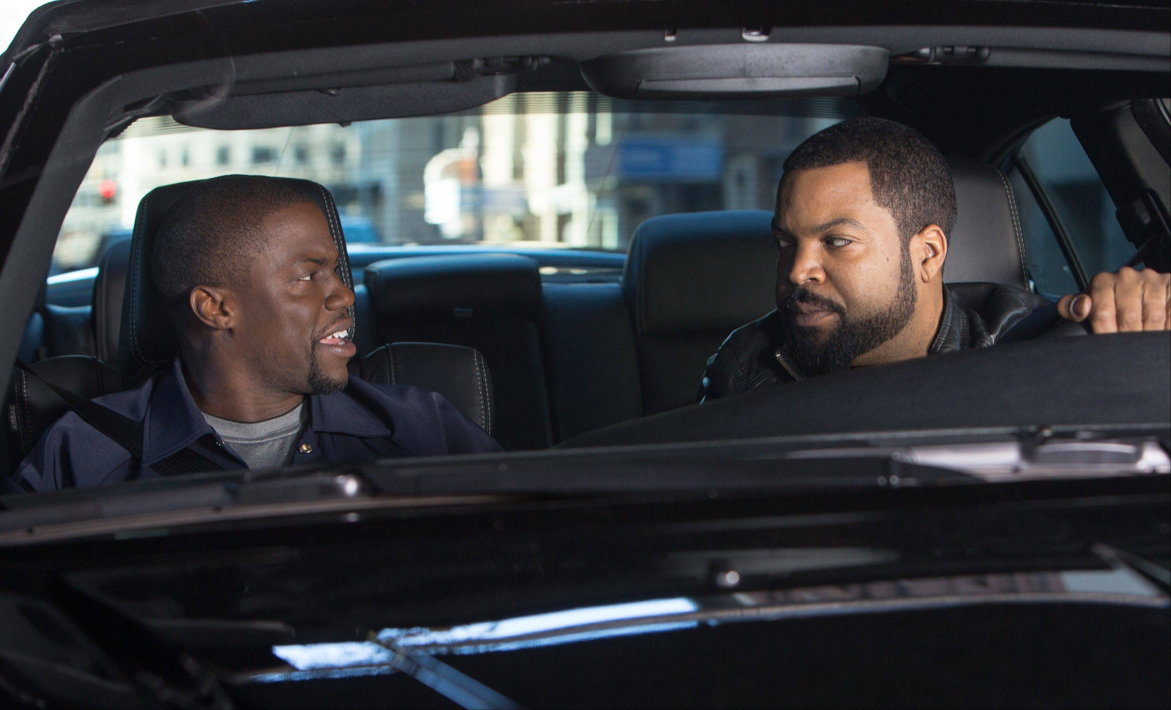 "Atlanta cop James (Ice Cube) right, tests Ben (Kevin Hart) with a taste of his police shift in the cliched action comedy ""Ride Along."""