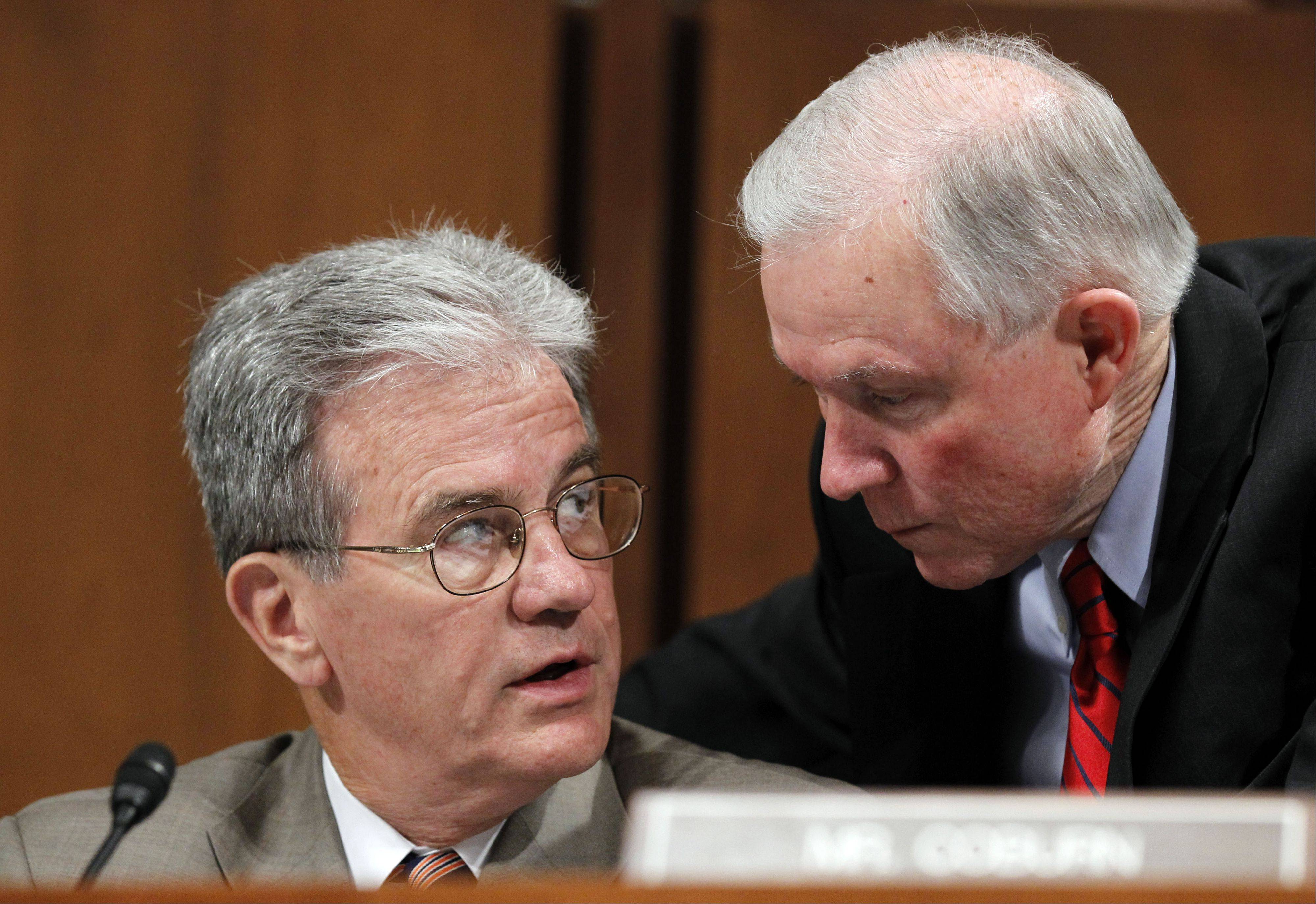 Sen, Jeff Sessions of Alabama, right, talks with Sen. Tom Coburn of Oklahoma on Capitol Hill in this file photo from June 30, 2010. On Thursday, Coburn announced his retirement at the end of 2014.