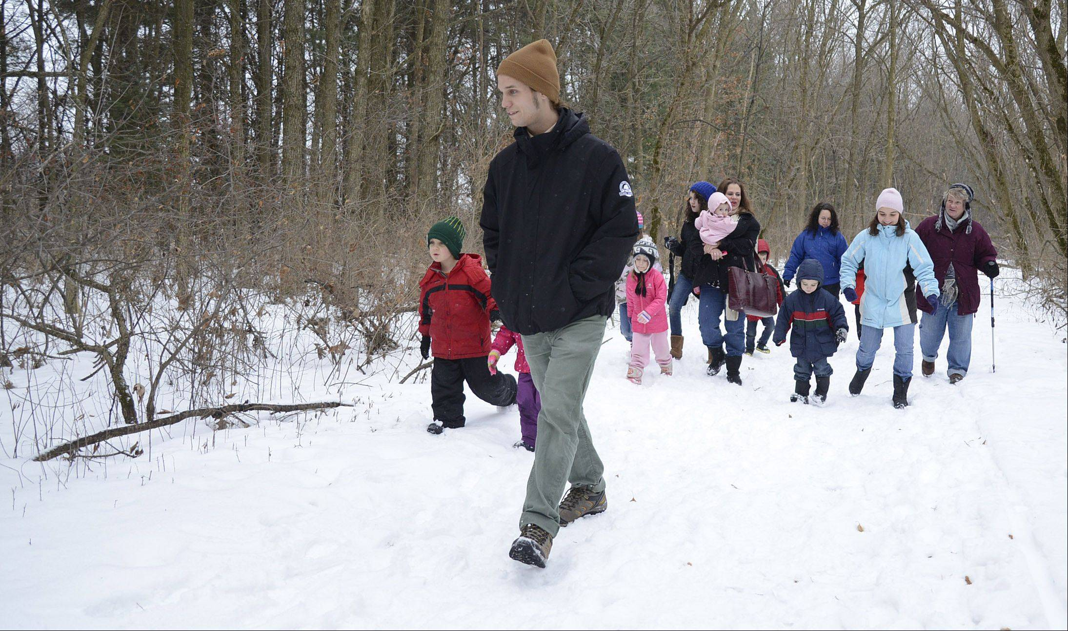 Kane County Forest Preserve naturalist Josh Libman leads students and parents on a trail Thursday at LeRoy Oakes Forest Preserve in St. Charles during the Homeschool Explorations: The Science of Snow program.