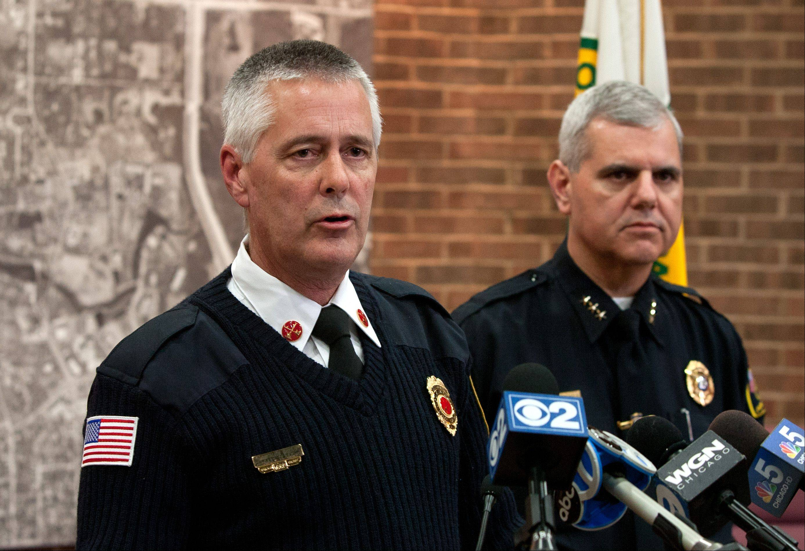 Acting Oak Brook Fire Chief Gary Clark, left, and Oak Brook Chief of Police James Kruger discuss their investigation of a fatal Carbon Monoxide poisoning death at a home in the 2900 block of Oak Brook Hills Road in Oak Brook.