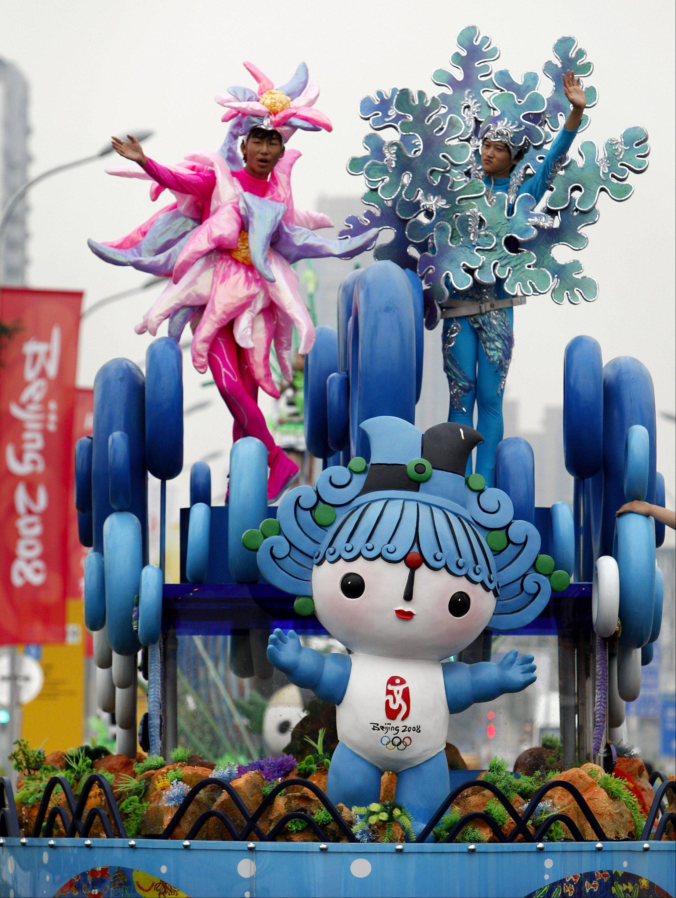 Leading this Beijing parade in 2008, Fuwa Beibei, the Olympic mascot representing the sea, also became part of a popular TV cartoon.