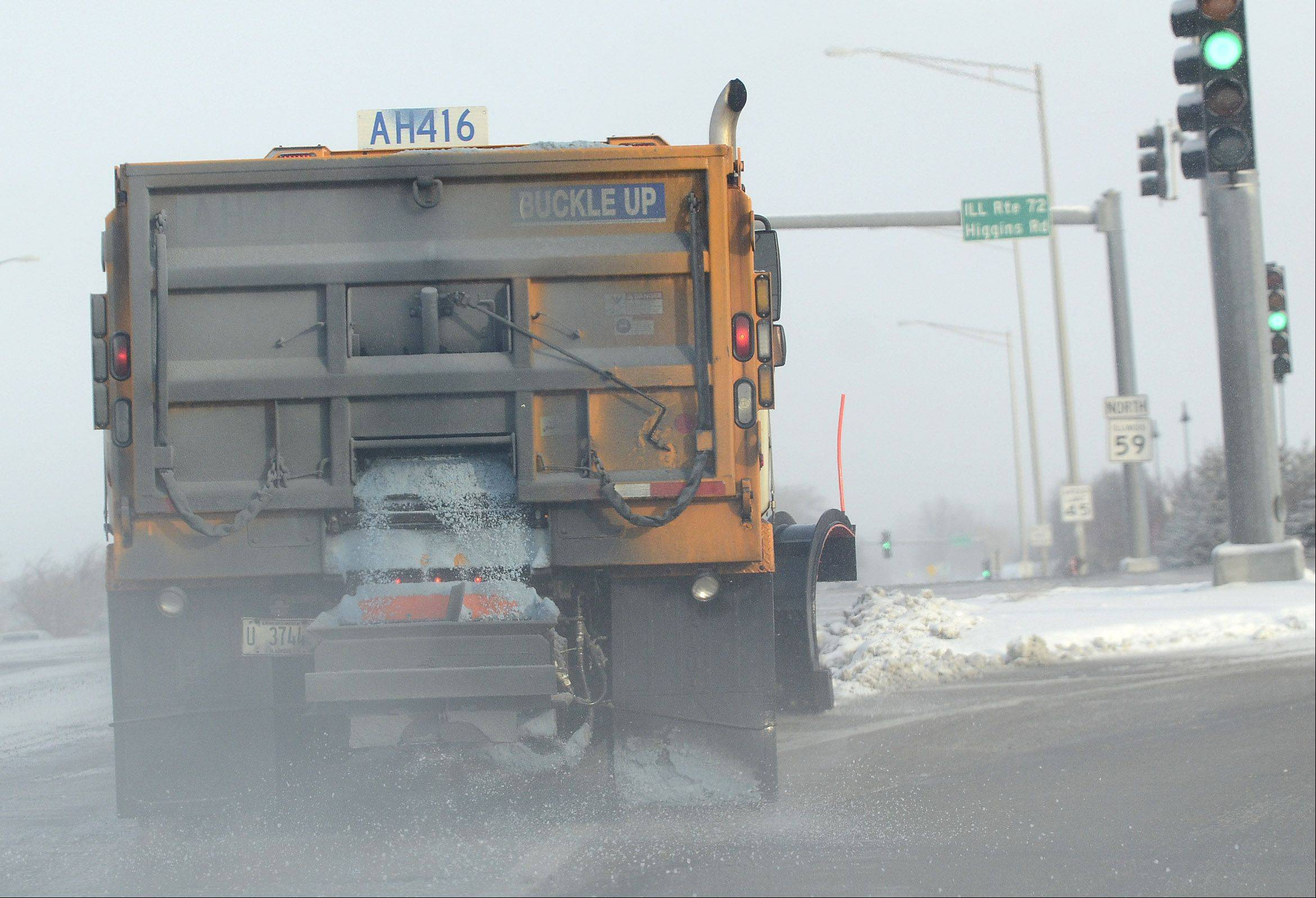 Salt trucks were out in force Wednesday morning along Higgins Road and Route 59 in South Barrington.