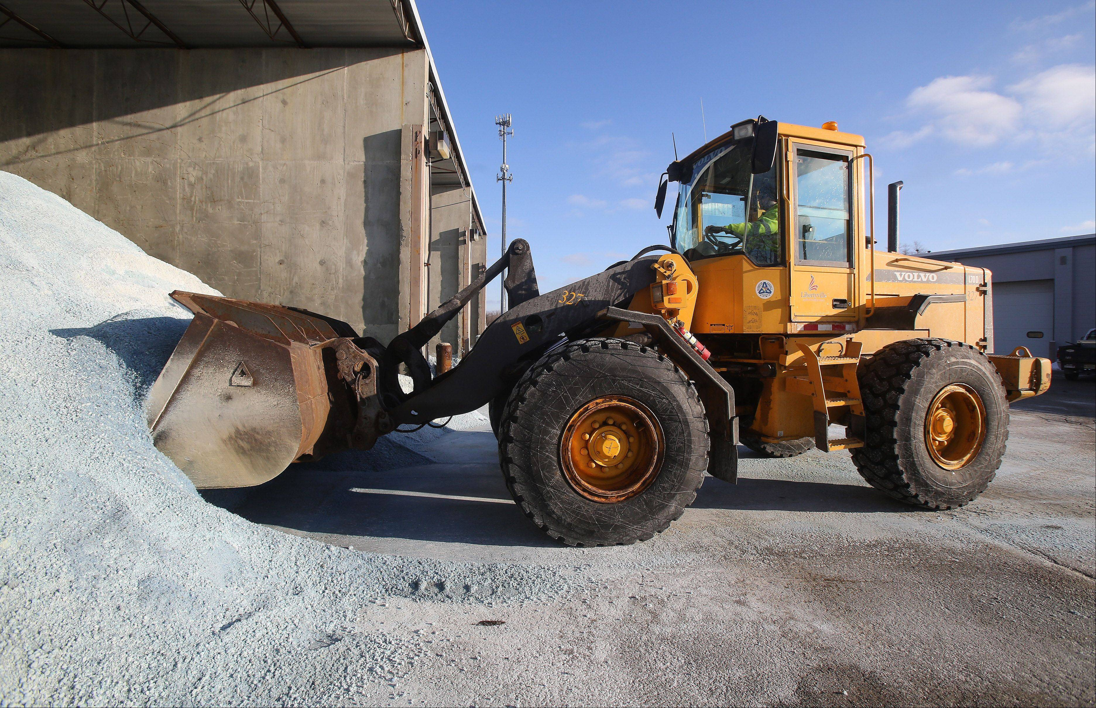 Maintenance tech T.J. Riley uses a front-end loader to move salt at the Libertyville public works department storage units on Wednesday.
