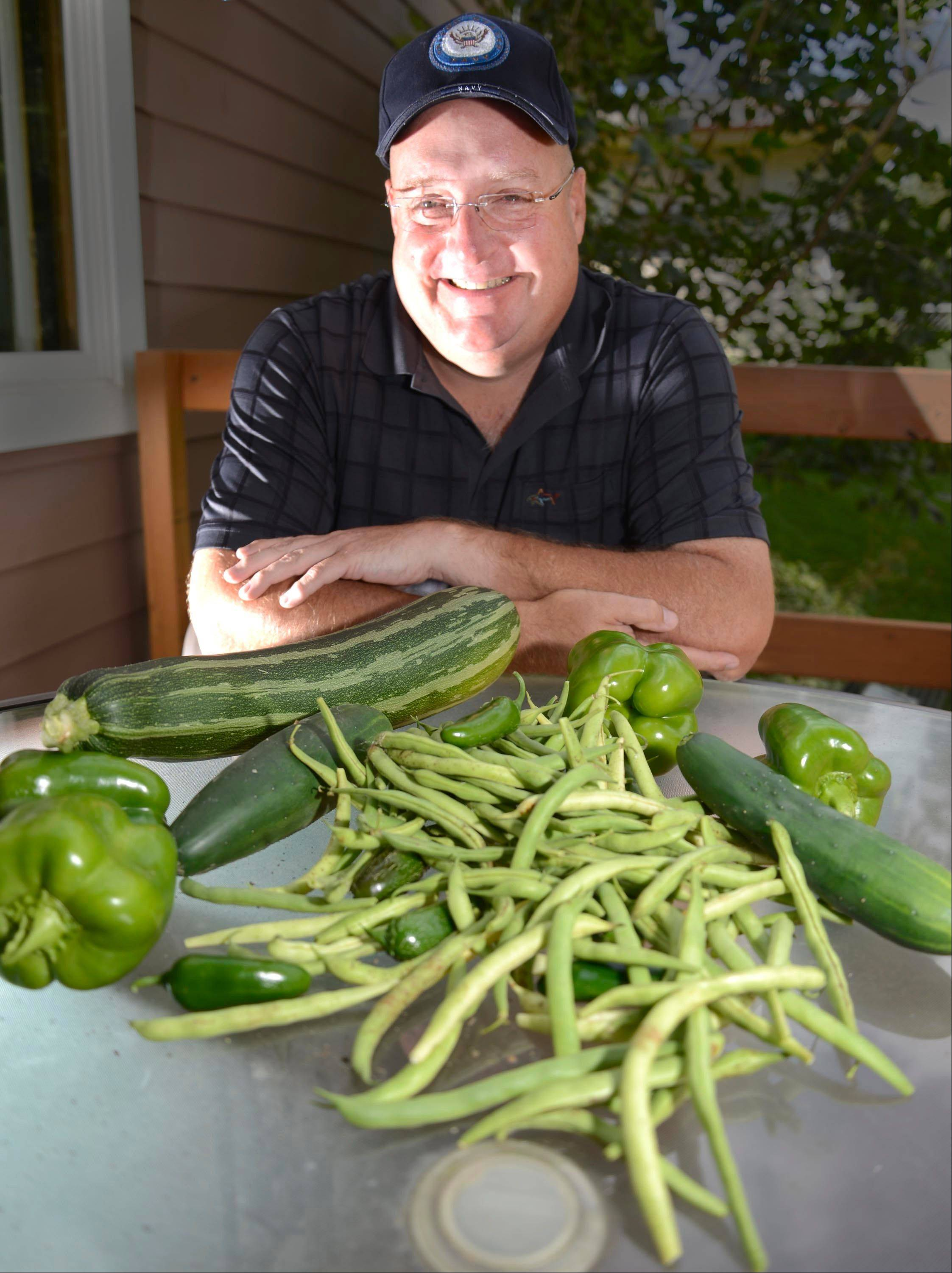 Cook of the Week Challenge champion Dan Rich of Elgin is shown with vegetables from his garden. Rich will be on hand at a Daily Herald event to help demonstrate creative snacking ideas for Super Bowl parties.