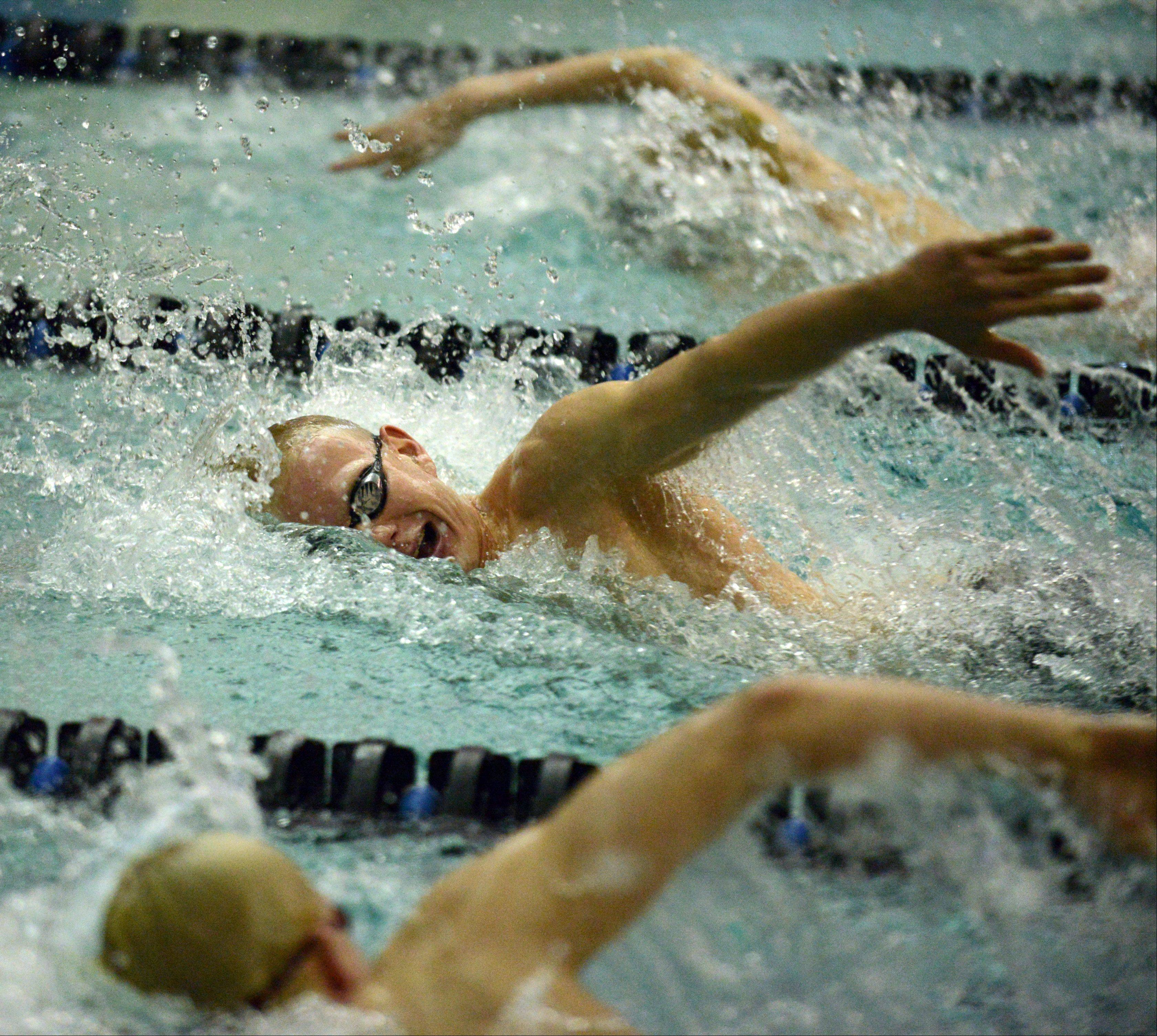 Benjamin Sherman of St. Charles North finished second in the 200-yard freestyle during swimming action at St. Charles North Thursday.