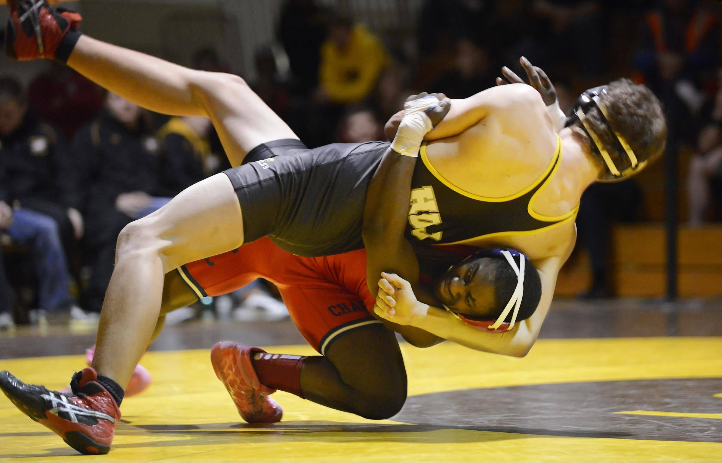 Dundee-Crown's DaShun Lloyd brings down Jacobs' Michael Bujocz Thursday in the 170-pound match in Algonquin. Bujocz was awarded the win after the referees determined Lloyd lost consciousness during the match and by rule was disqualified.