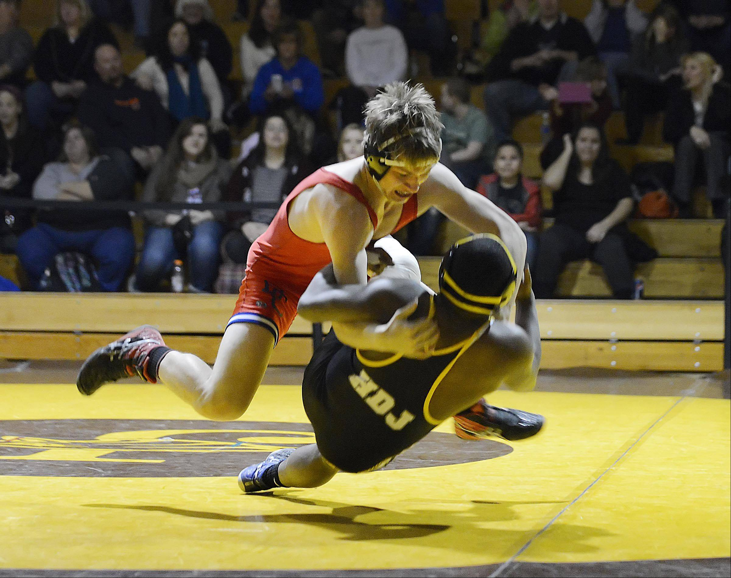 Dundee-Crown's Jarrod Raap and Jacobs' Charles Goins fall to the mat during their 182-pound match Thursday in Algonquin.
