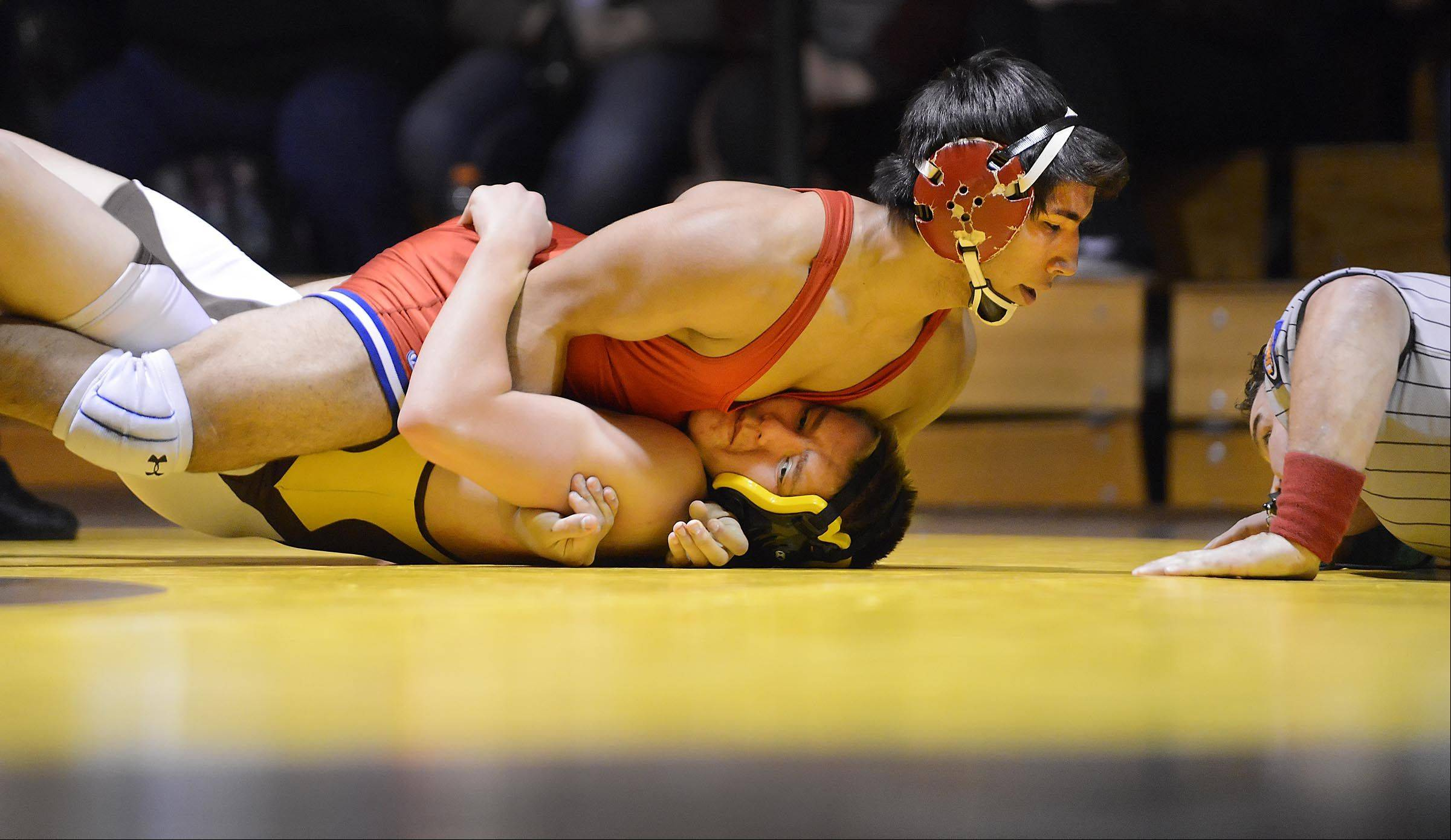 Jacobs' Matt Kuhns is pinned by Dundee-Crown's Armando Gutierrez in their 152-pound match Thursday in Algonquin.