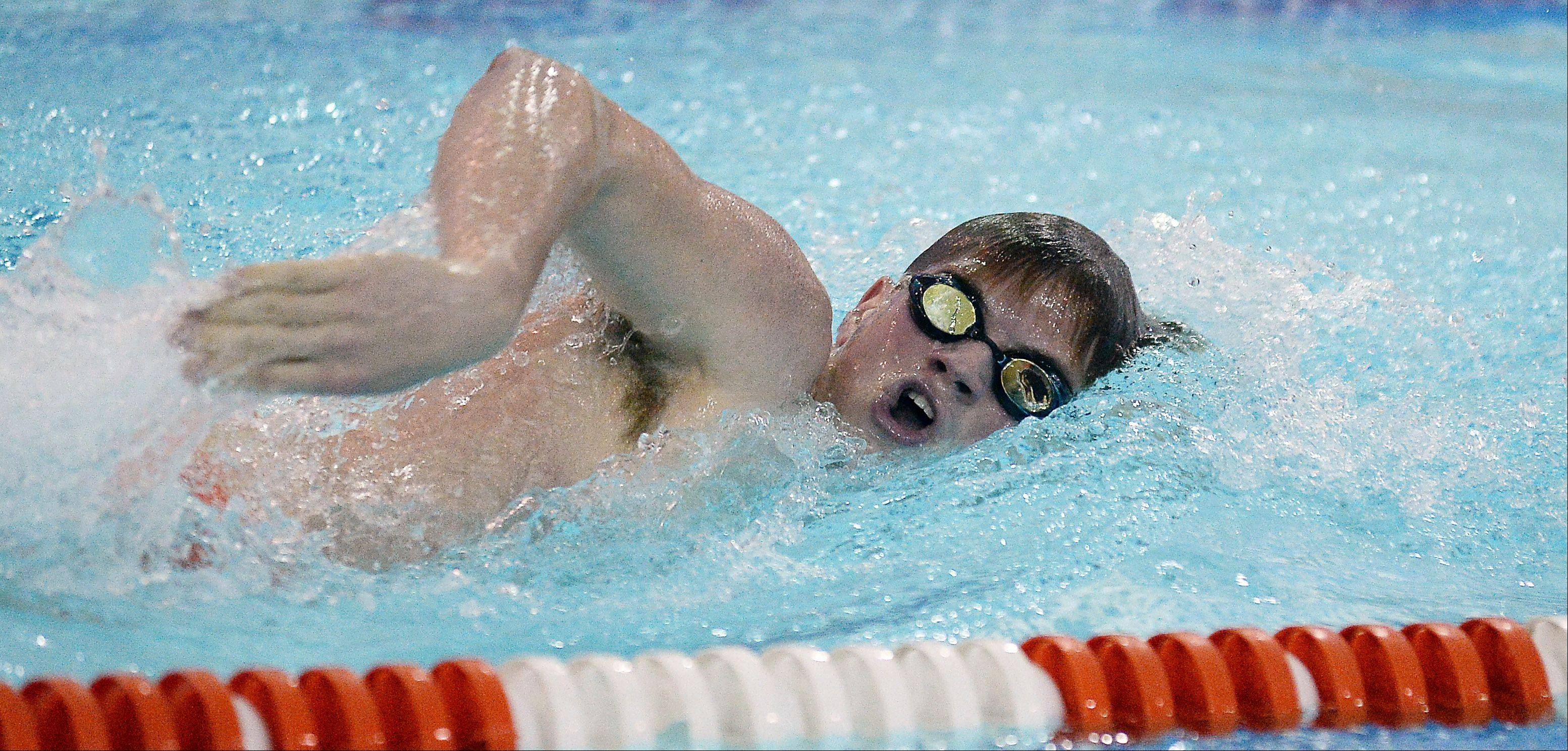 Mark Welsh/mwelsh@dailyherald.comHersey's David Kuntz powers his way through the 200-yard freestyle against Buffalo Grove on Thursday.