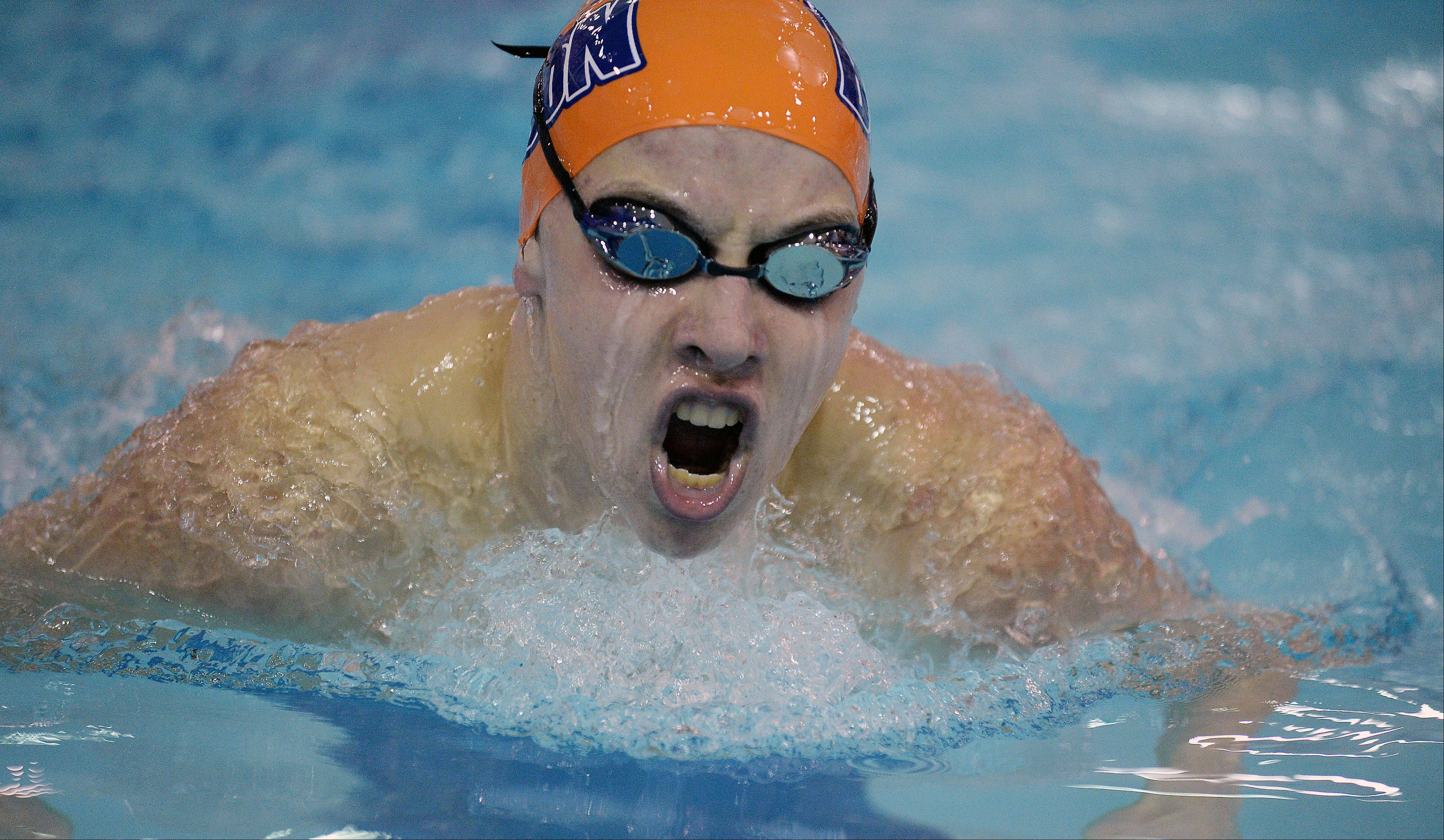 Buffalo Grove's KC Lotzer surges to a winning effort in the 200 IM on Thursday at Olympic Pool in Arlington Heights.