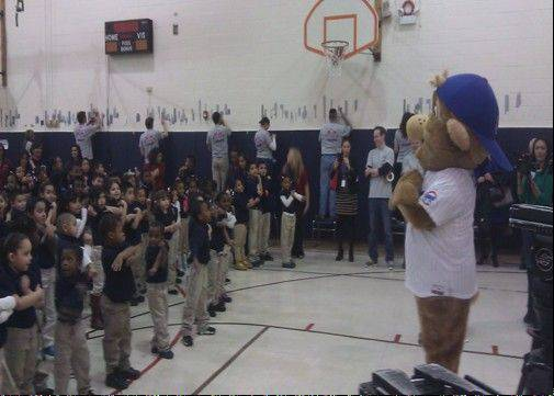 Cubs mascot Clark greets students at Casals School in Chicago during a Cubs Caravan stop on Thursday.