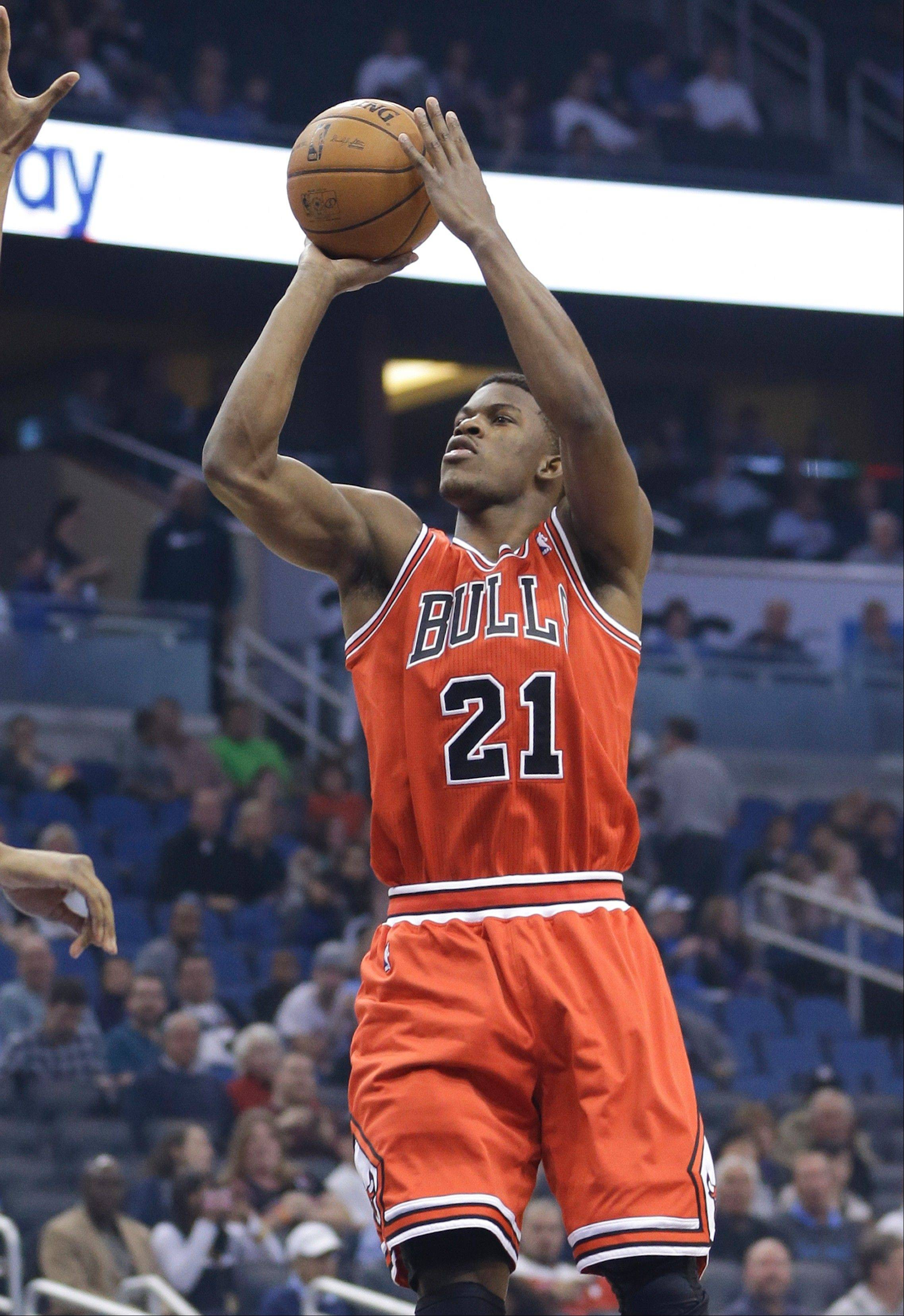 Jimmy Butler takes a shot against Orlando during the first half of the Bulls' triple-overtime win Wednesday. Butler logged a team record 60 minutes, 20 seconds and scored 21 points.