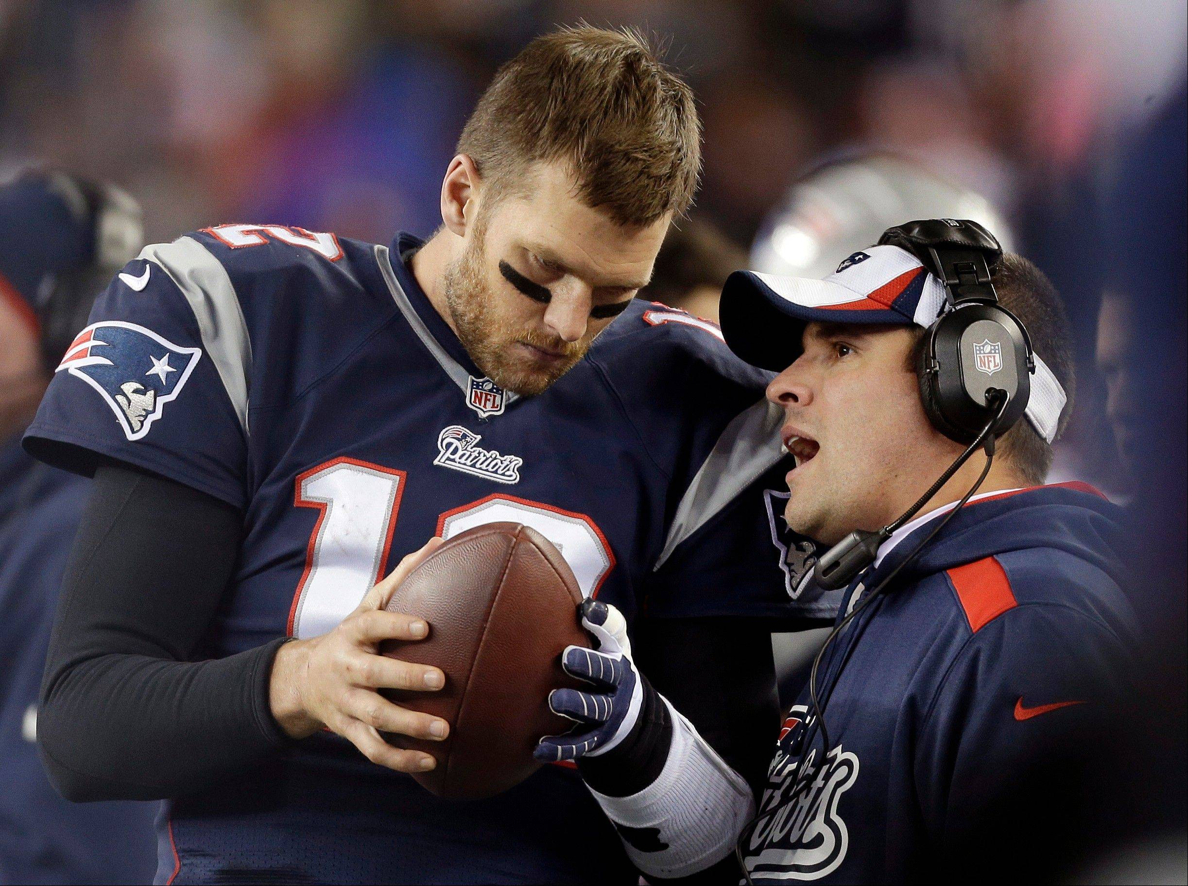 FILE - In this Nov. 3, 2013, file photo, New England Patriots offensive coordinator Josh McDaniels, right, talks to quarterback Tom Brady during the fourth quarter of an NFL football game against the Pittsburgh Steelers in Foxborough, Mass. No name stirs up quite as much angst and anger around Denver as McDaniels. The former Broncos coach, now offensive coordinator for the Patriots, left havoc in the wake of his two-year stint in Denver, and has a chance to leave another scar when the Patriots meet the Broncos in the AFC championship game on Sunday.