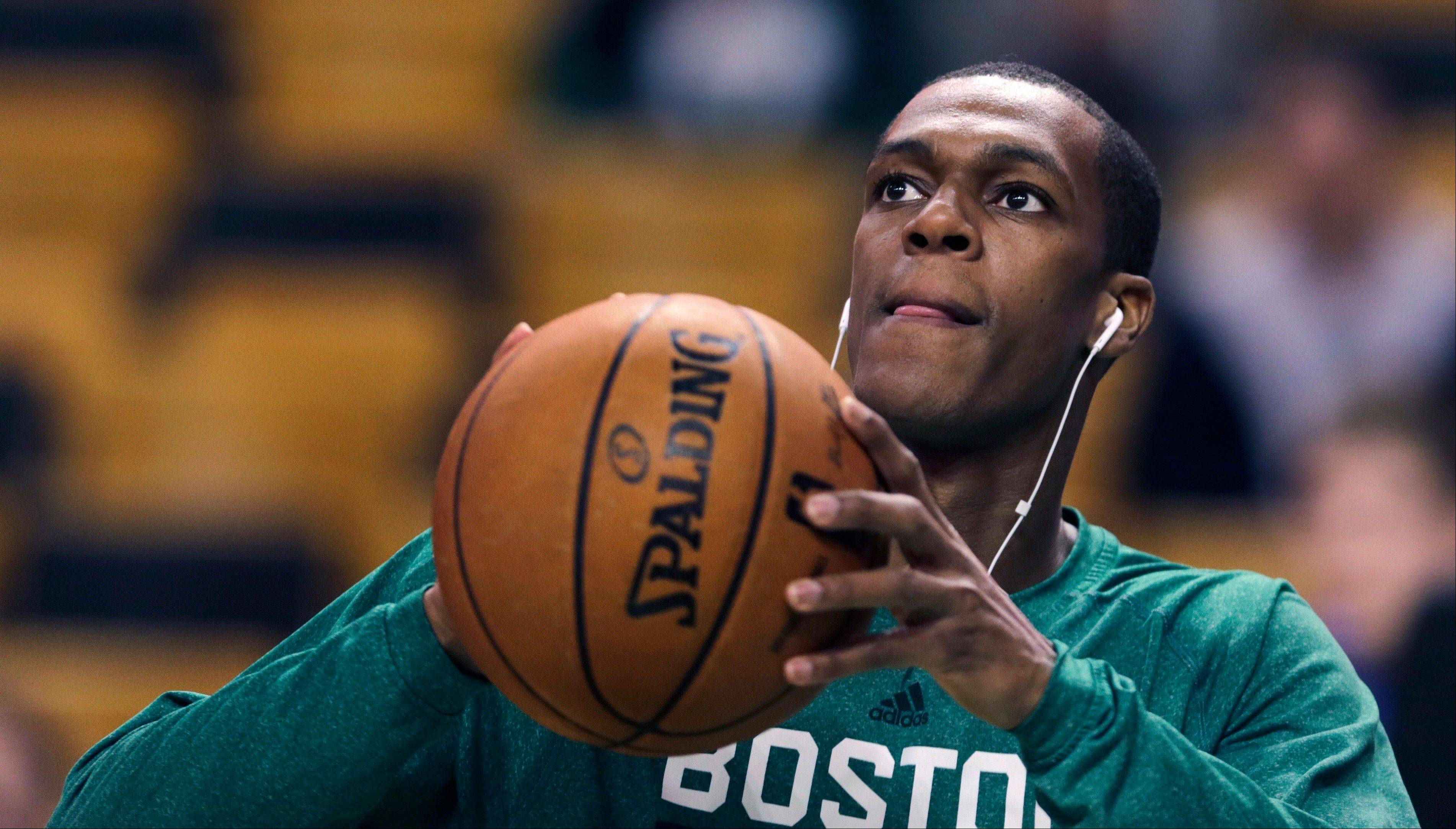 Boston Celtics guard Rajon Rondo takes a shot prior to the Celtics' NBA basketball game against the Toronto Raptors, in Boston on Wednesday, Jan. 15, 2014. Rondo took a step toward returning to action on Wednesday, working out with members of Boston's NBA Development League team at the Celtics' practice facility earlier in the day.