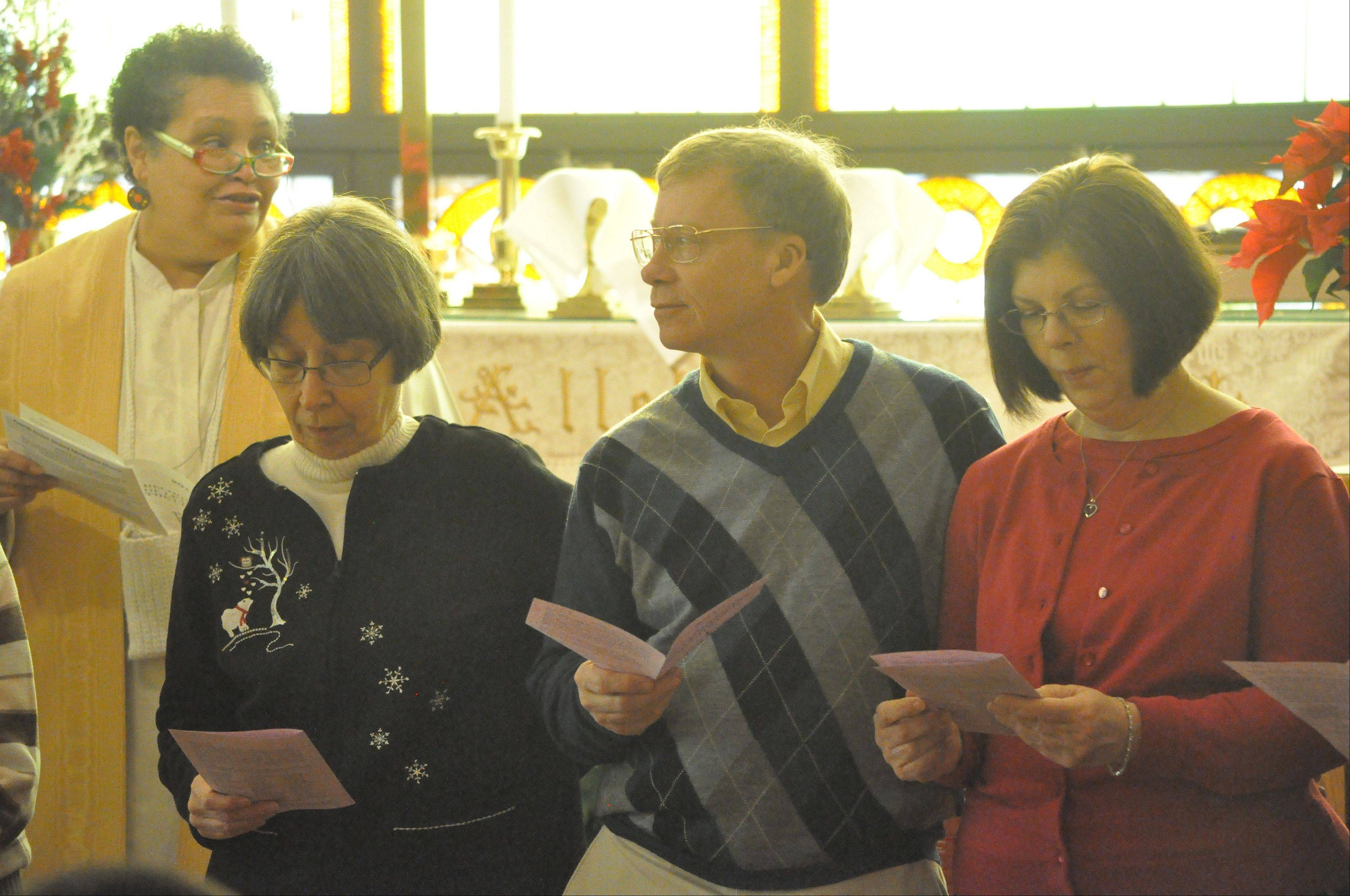 North Aurora resident Roger Spurgin, second from right, was among 45 people honored as leaders at Fourth Street United Methodist Church in Aurora Jan. 12. From left are the Rev. Deborah Tinsley Taylor, church pastor; Louise Hari, Aurora; Spurgin; and Linda Lipsey, Aurora. The first leader-recognition ceremony was held during 10 a.m. worship.