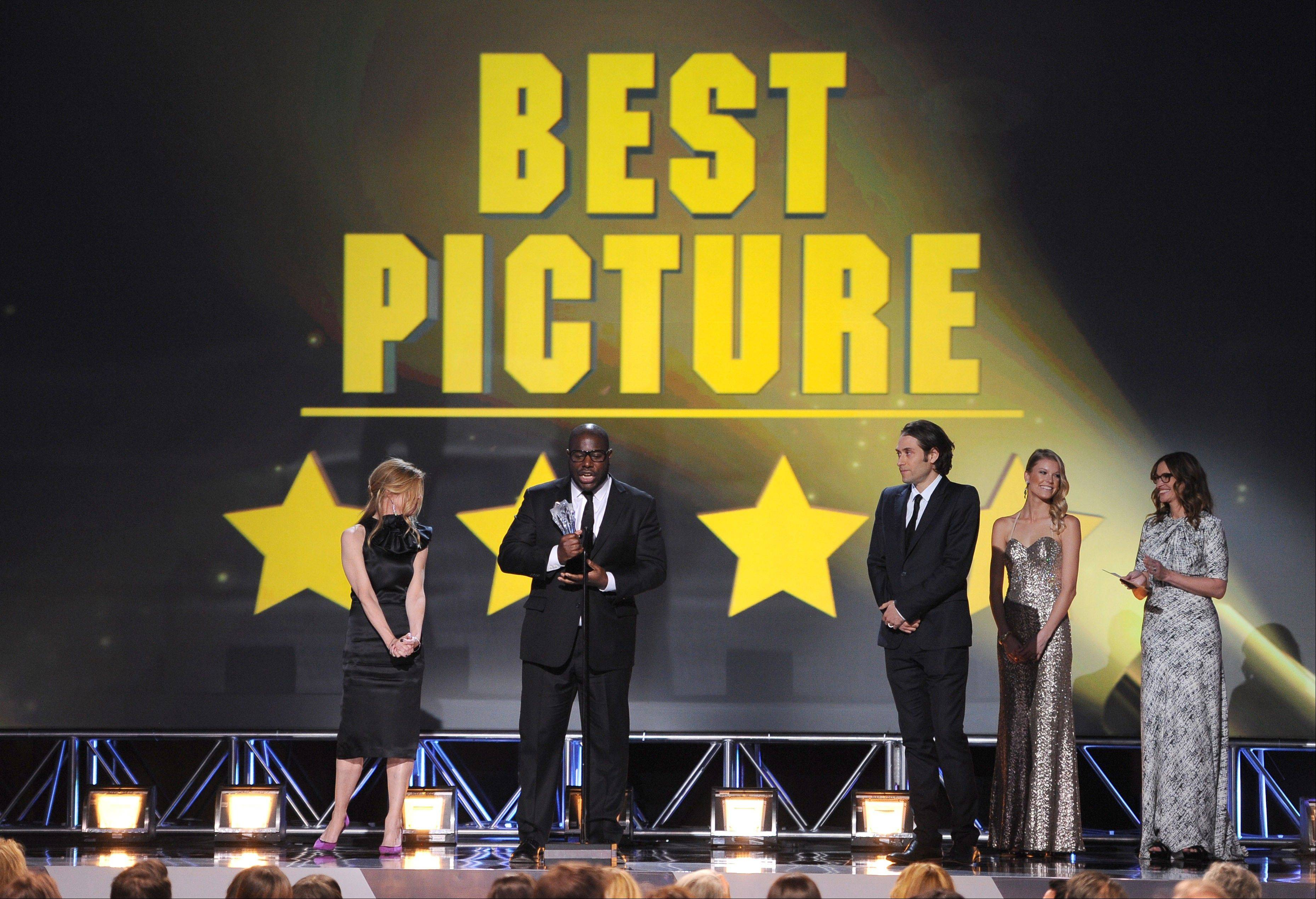 Dede Gardner, left, Steve McQueen, and Jeremy Kleiner accept the award for best picture for �12 Years a Slave� at the 19th annual Critics� Choice Movie Awards Thursday in Santa Monica, Calif.