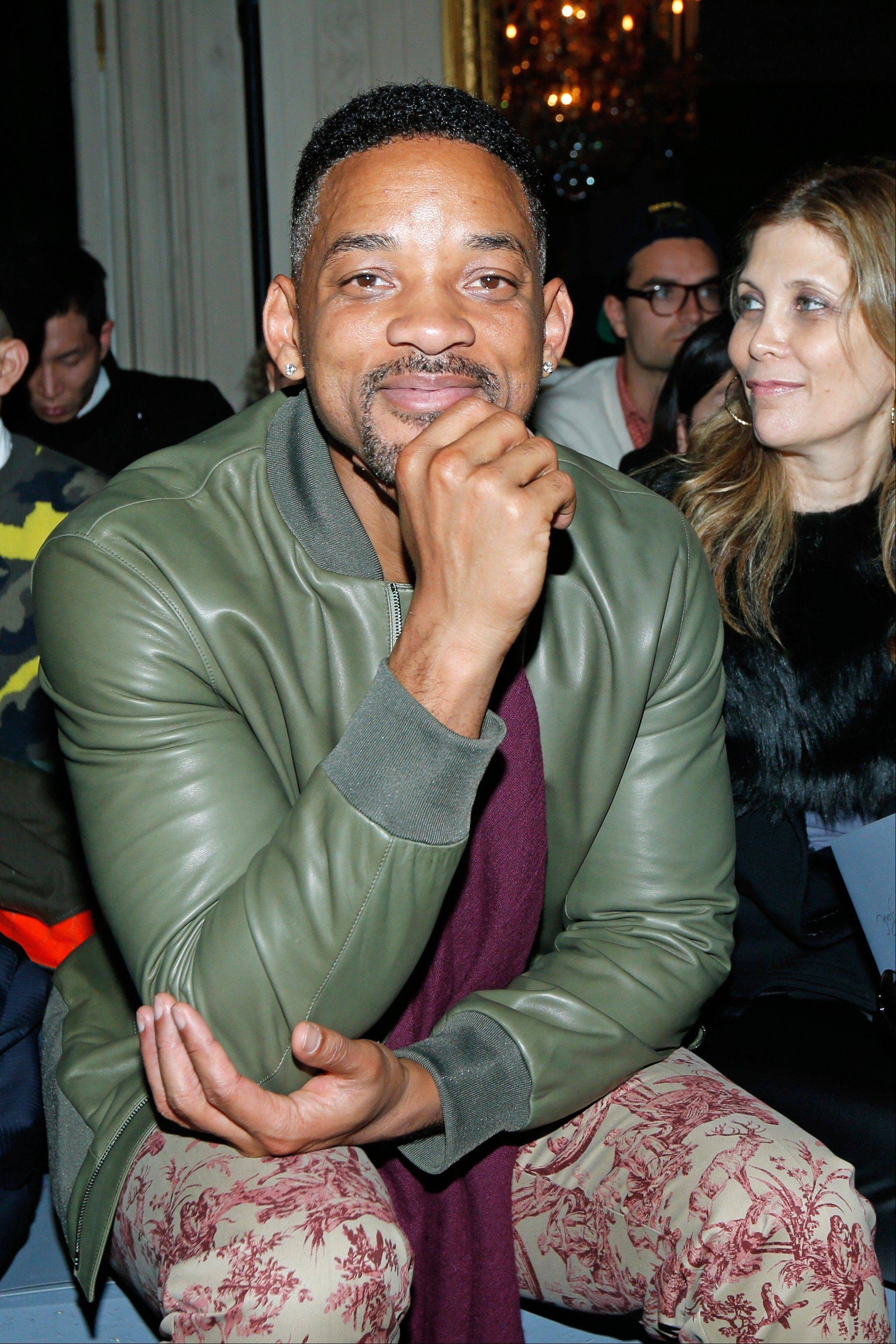 Actor Will Smith, wearing all Valentino, attends the Valentino�s men�s Fall-Winter 2014-2015 fashion collection Wednesday in Paris.