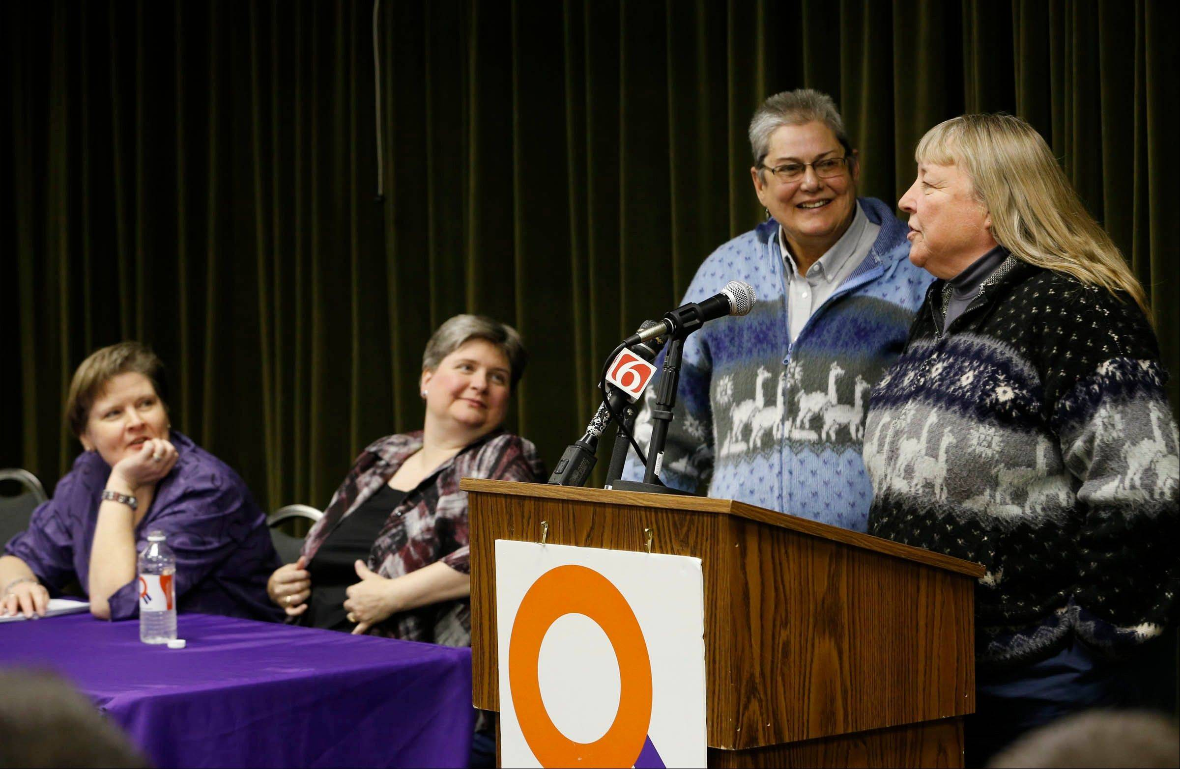 Mary Bishop, left, and her partner Sharon Baldwin listen as Sue Barton and her partner Gay Phillips speak to guests during a celebration Tuesday at the Dennis R. Neill Equality Center, in Tulsa, Okla. A federal judge struck down Oklahoma�s gay marriage ban Tuesday, but headed off any rush to the altar by setting aside his order while state and local officials complete an appeal.
