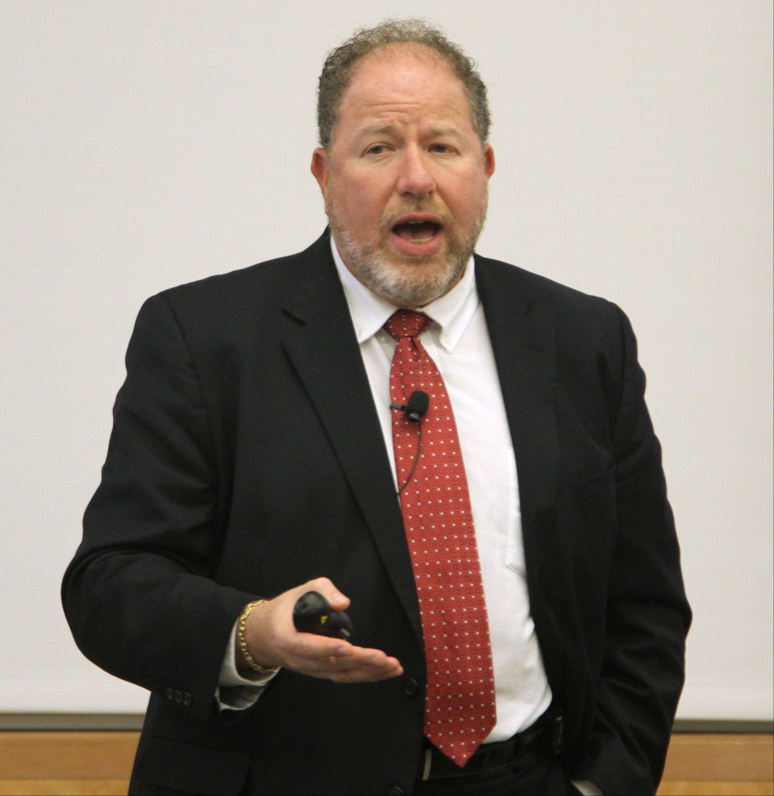 William Strauss, senior economist and economic adviser for the Federal Reserve Bank of Chicago, explains his 2014 outlook at Friday�s 7th annual Economic Forecast Lake County luncheon at the University Center at the College of Lake County in Grayslake.