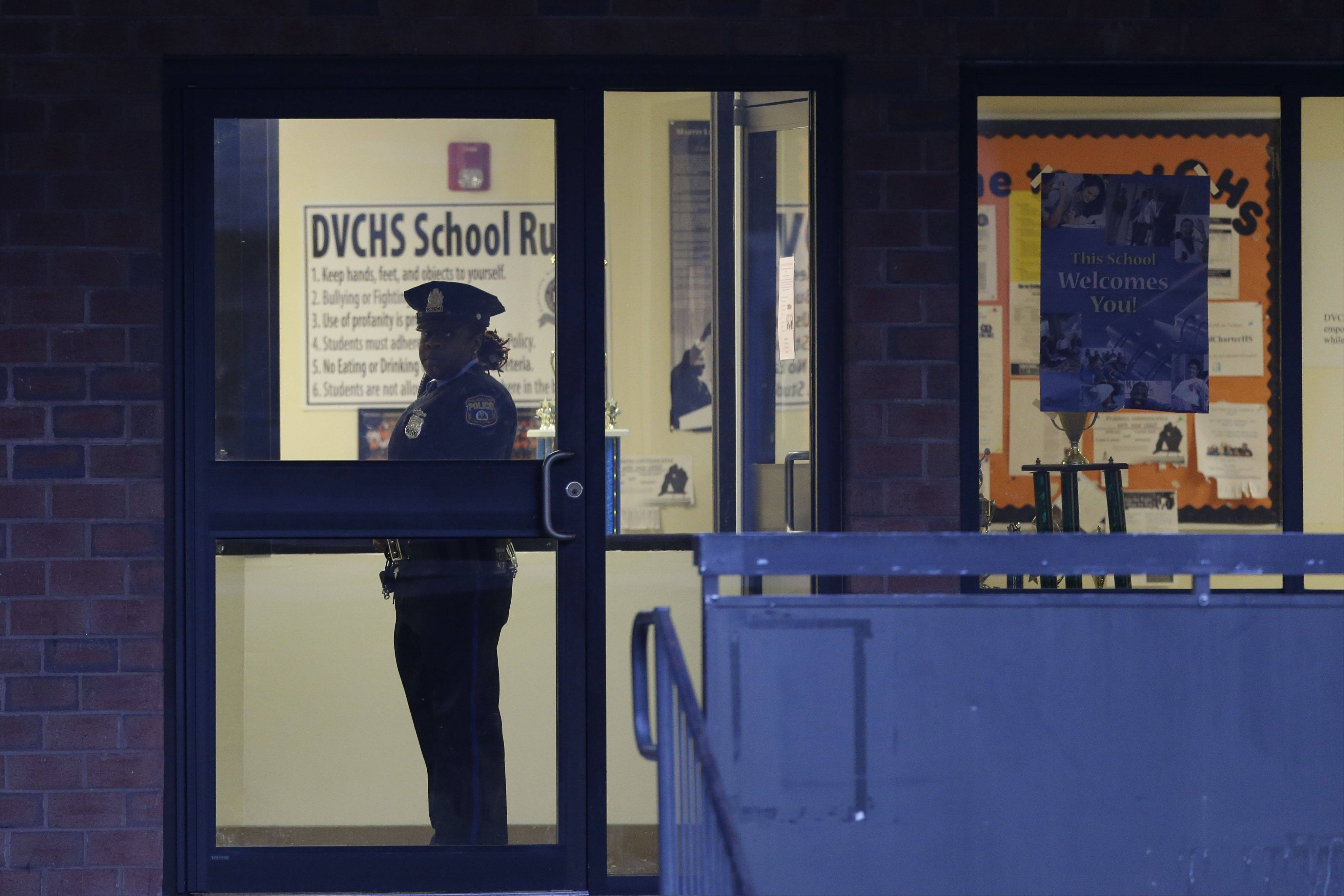 Police stands guard the Delaware Valley Charter School Friday.