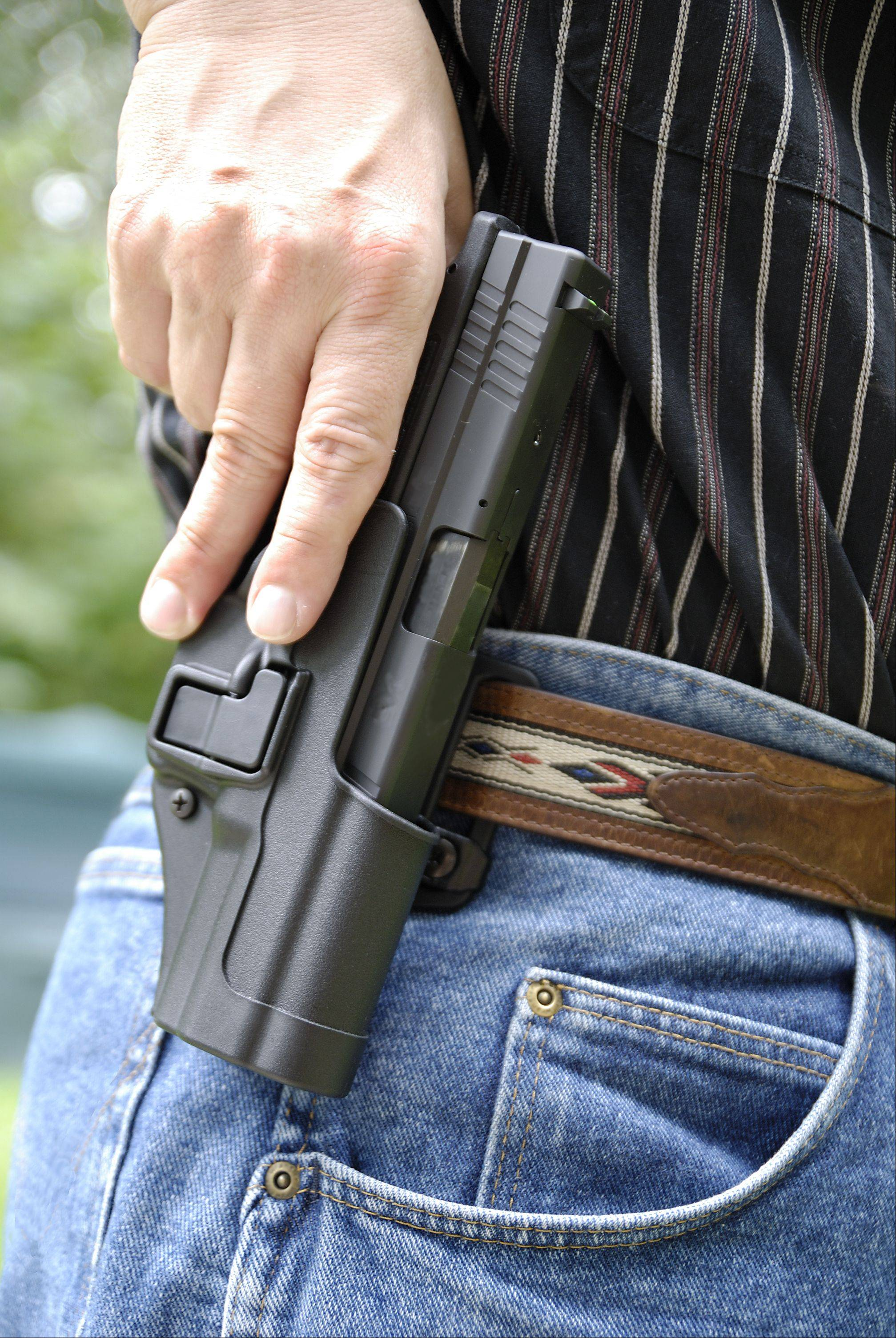 Businesses, churches mull concealed carry rules