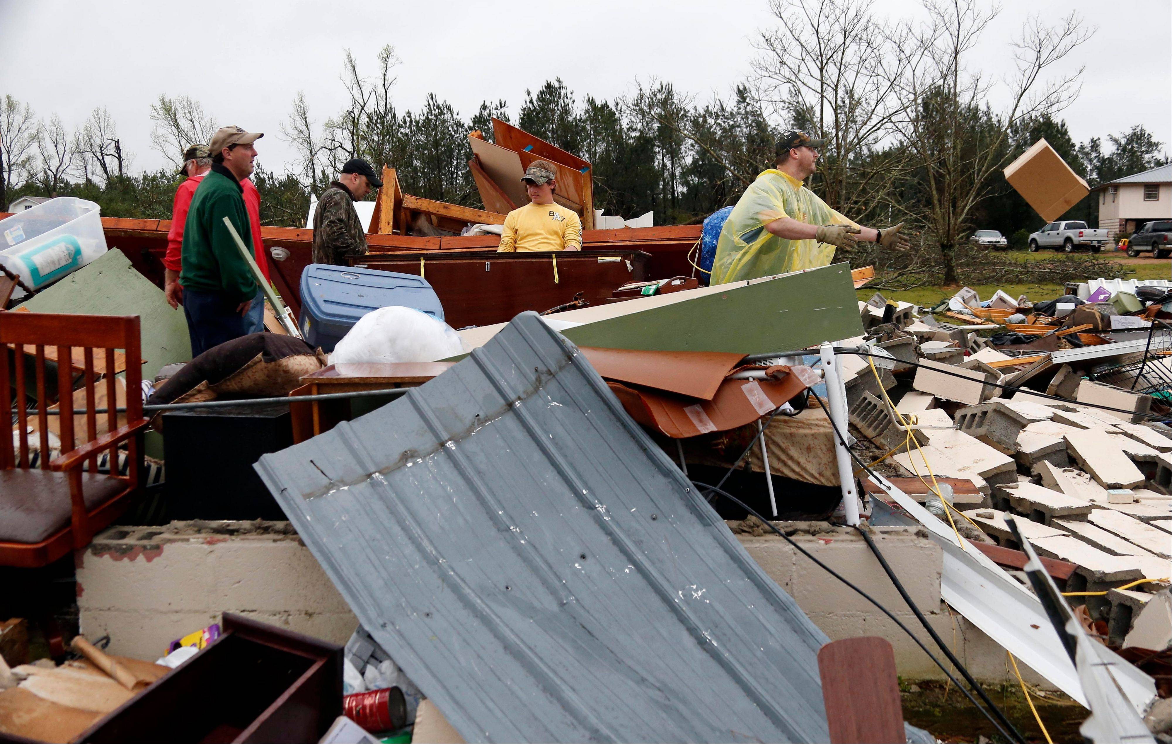 Residents begin cleanup after a tornado plowed through rural sections of eastern Mississippi, killing at least one person and causing widespread damage and power outages last spring. The Storm Prediction Center plans to broaden its days-in-advance warning system for severe weather after finding the days labeled with a �Slight Risk� tag turned out to have storms that were fairly stout � and even deadly.