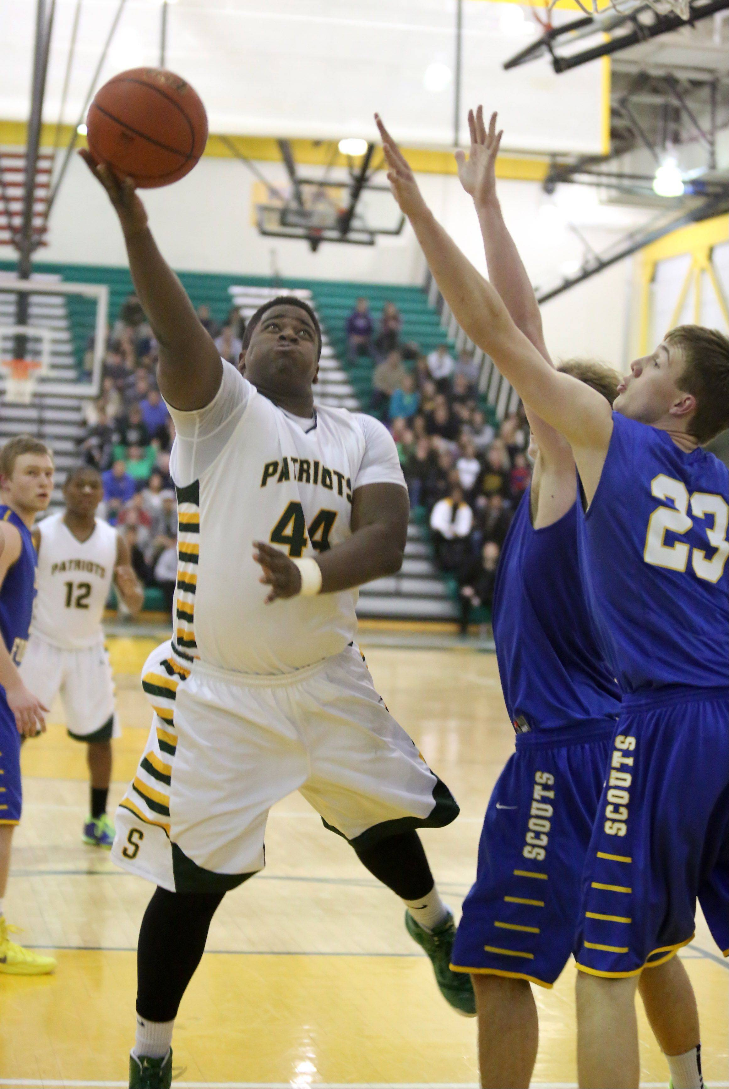 Stevenson forward Nick Dillon shoots the ball against Lake Forest defender Steve Vogrich at Stevenson on Friday.