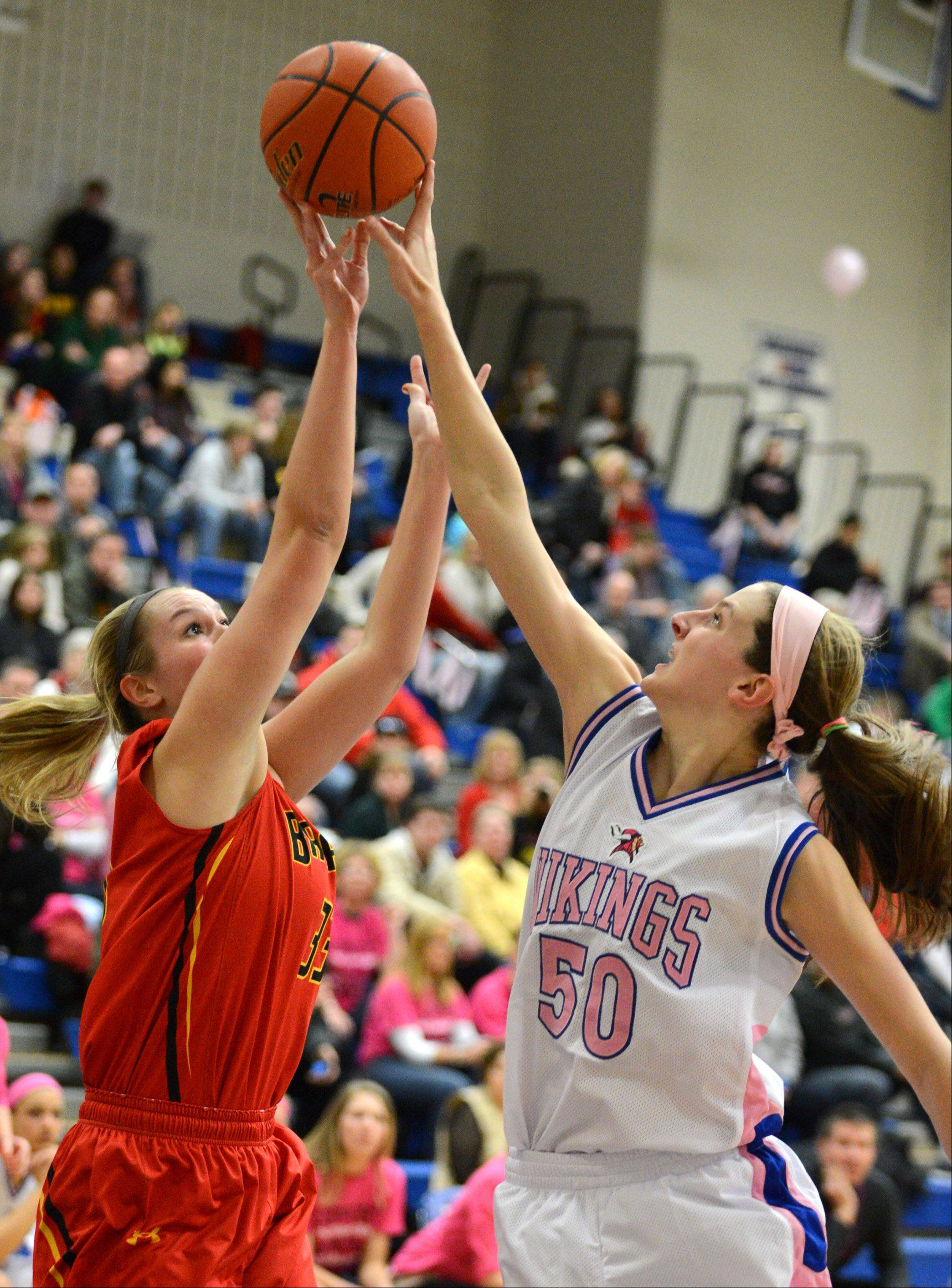 Geneva�s Grace Loberg blocks a shot by Batavia�s Erin Bayram (33) during Friday�s game in Geneva.