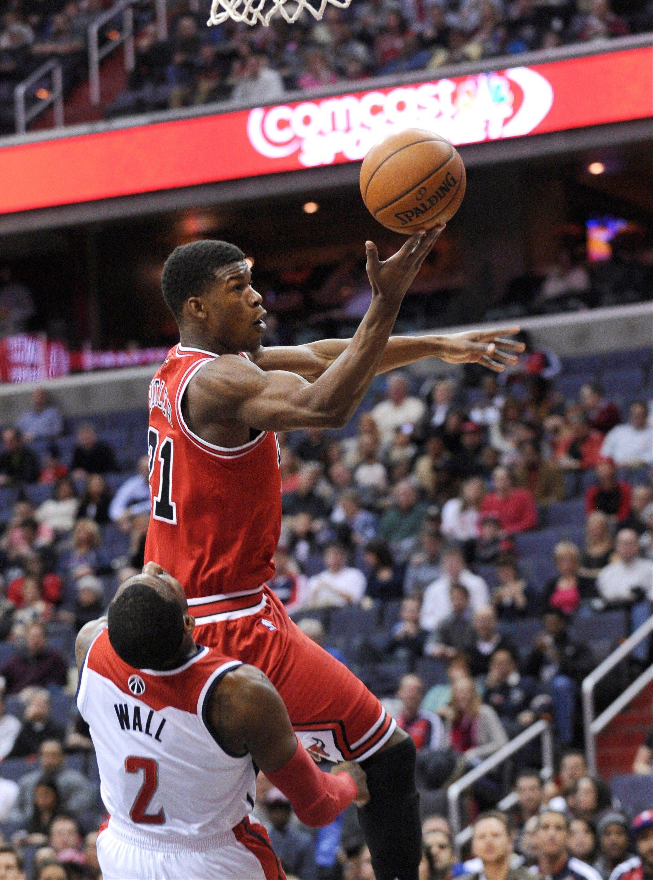 The Bulls� Jimmy Butler makes a strong move to the basket over John Wall of the Wizards on Friday in Washington.